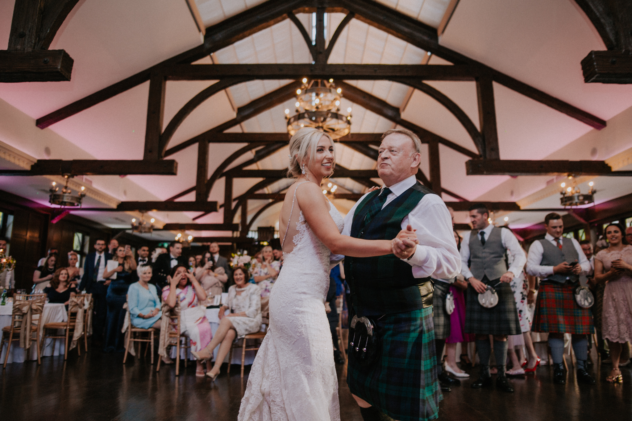 The bride is dancing with her dad