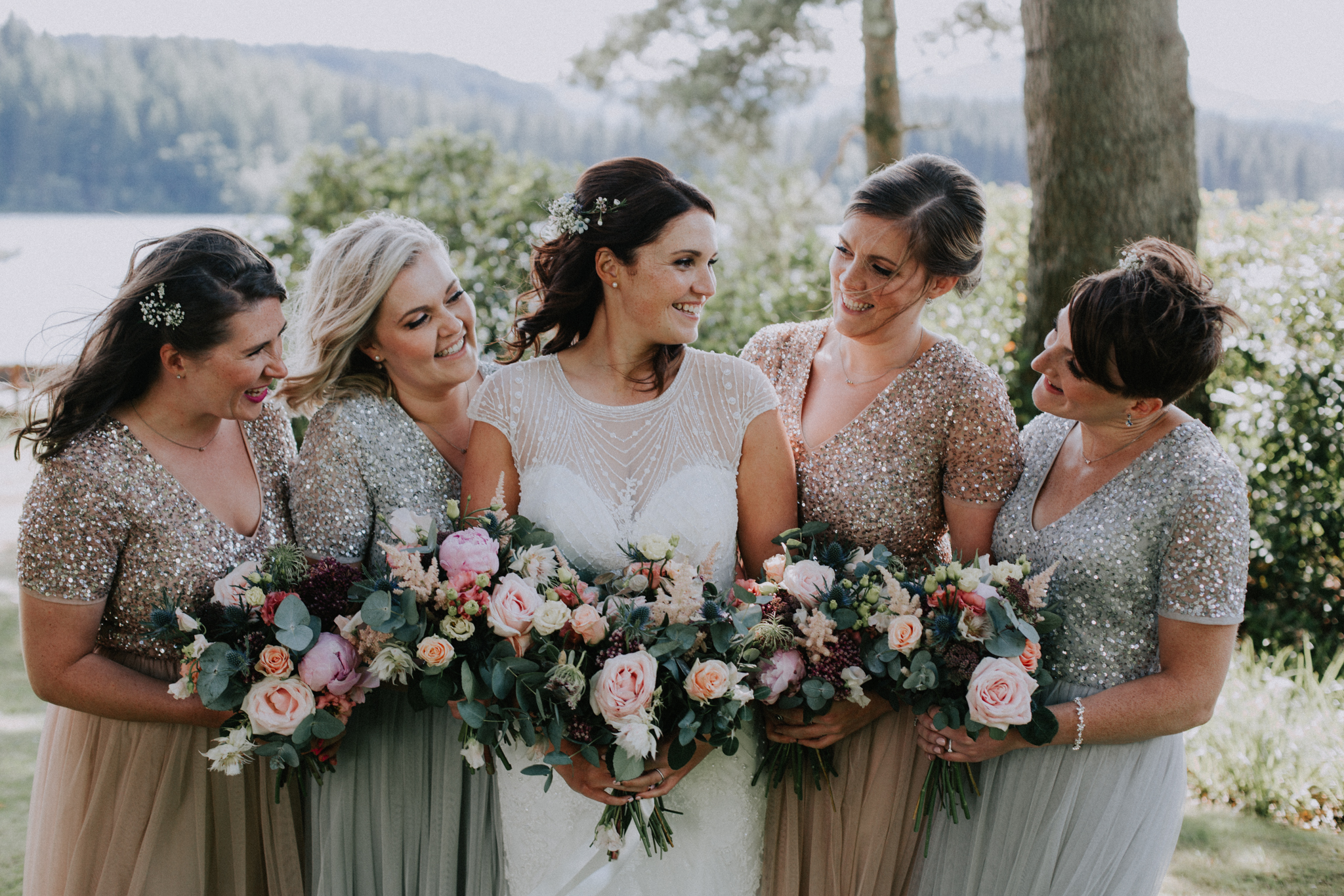 A beautiful portrait of the bridesmaids with the bride