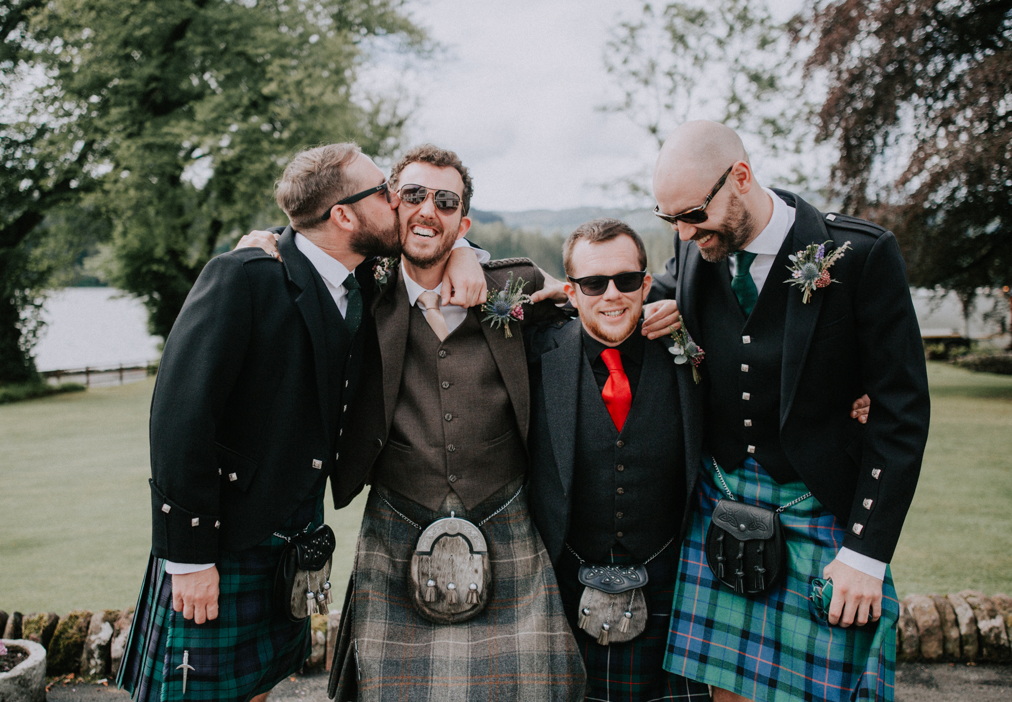 Groom and groomsmen on informal portrait in front at Altskeith Country House