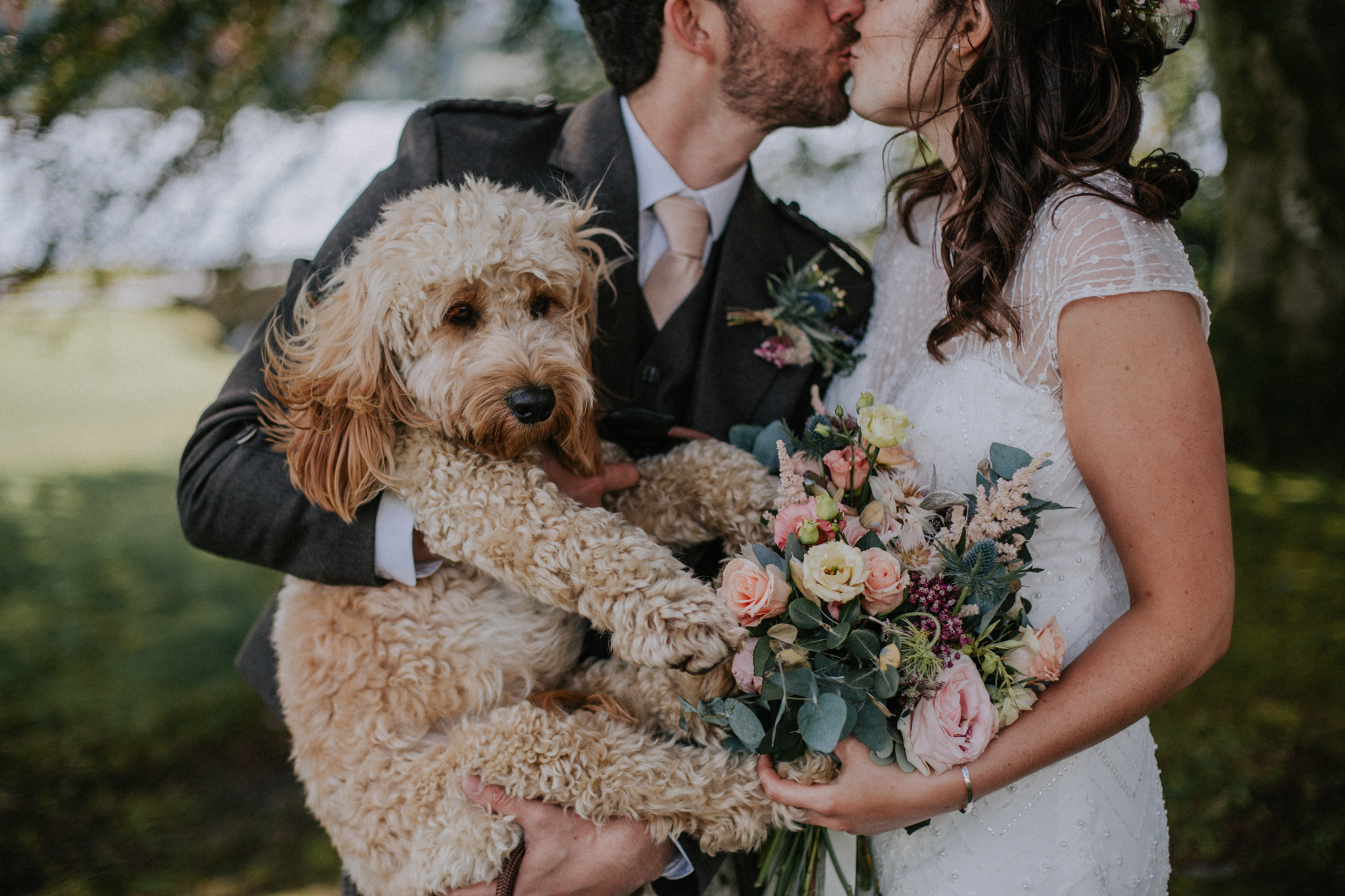 Close up portrait of the couple and their dog