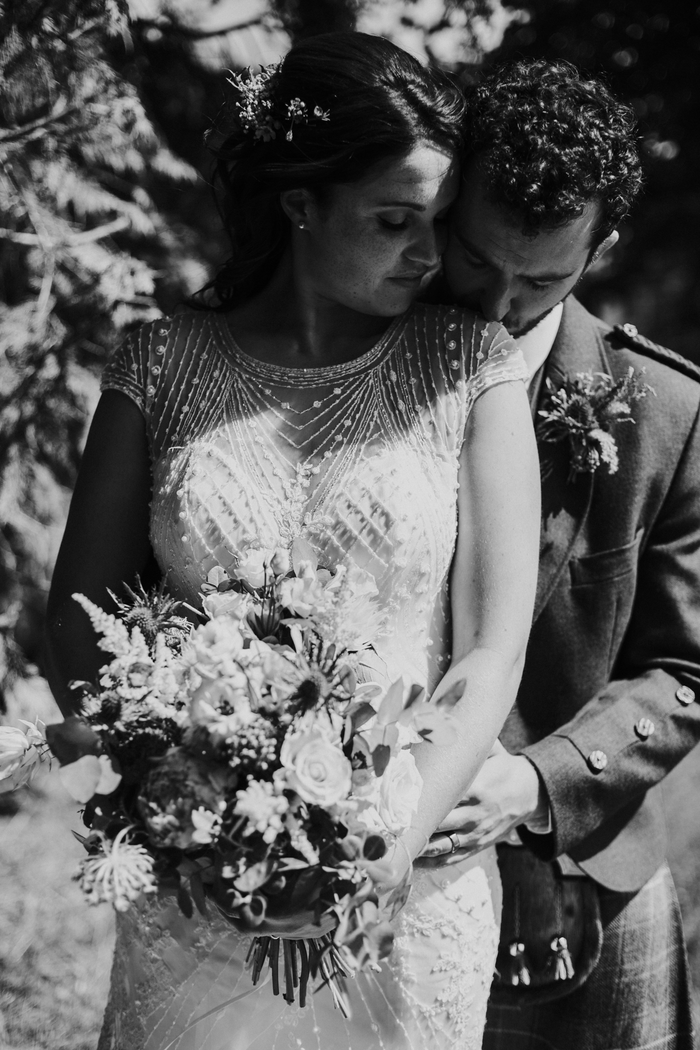 Black and white close up portrait of the newlyweds