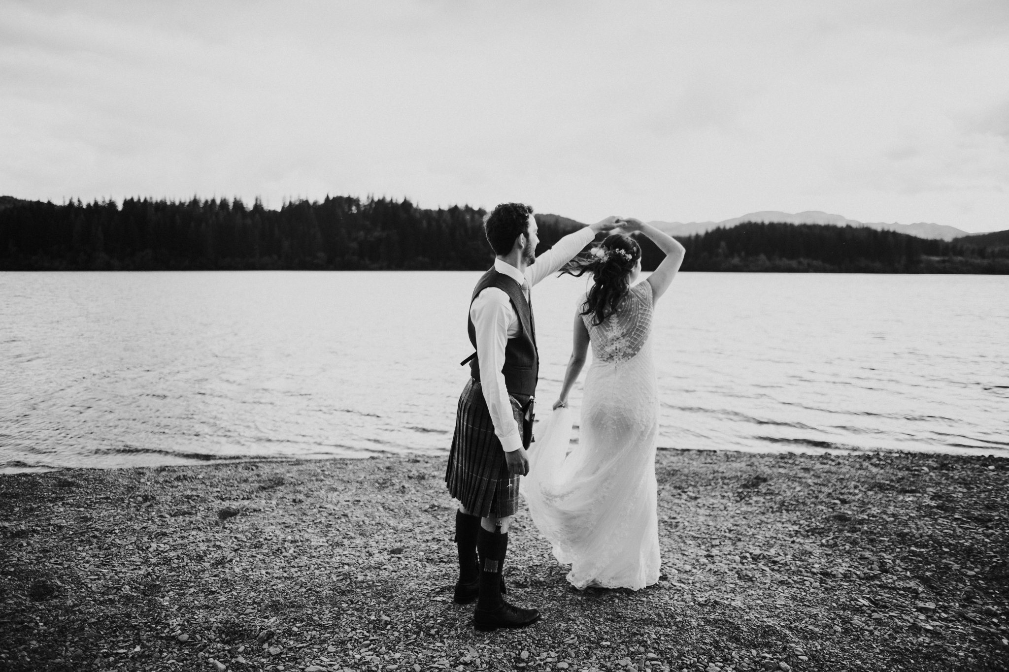 The couple is dancing on Loch Ard shores in Scotland