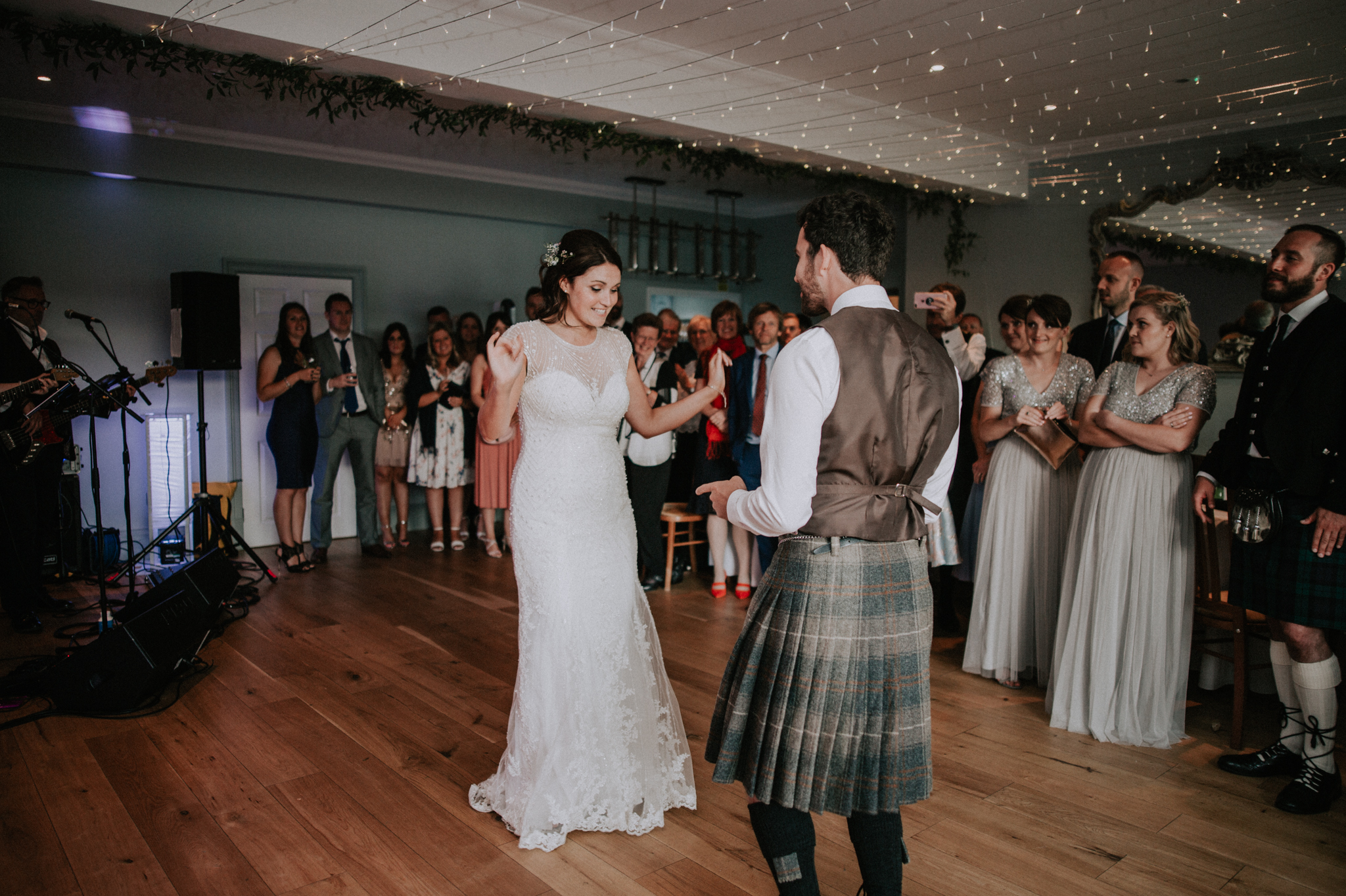 The newlyweds are dancing their first dance as a husband and wife