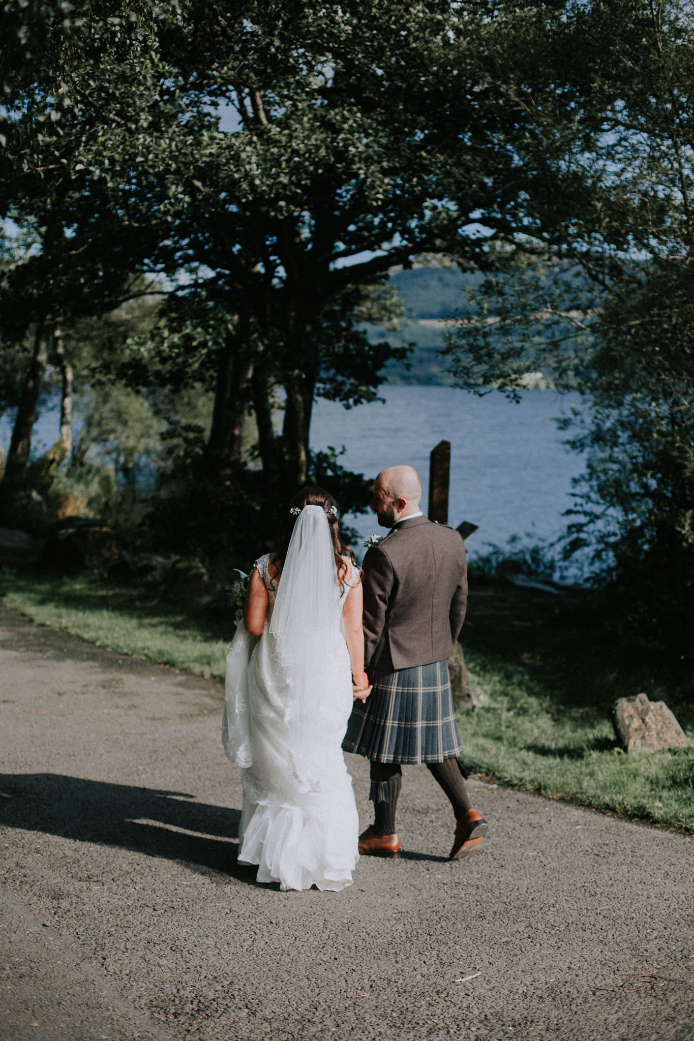The couple is walking down to the loch for the photo shoot