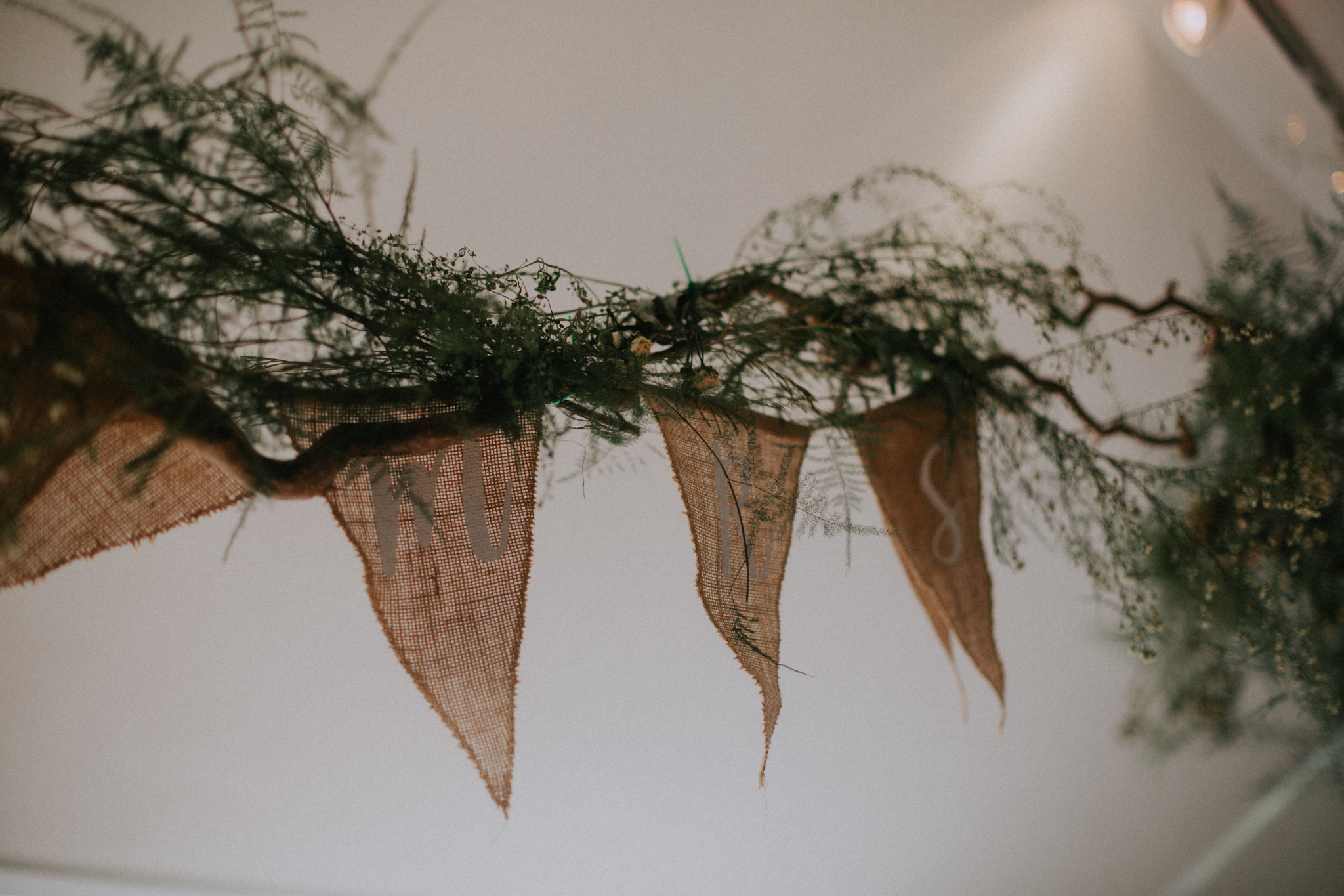 A green, natural and rustic foliage on the ceiling at the Venachar Lochside weeding venue
