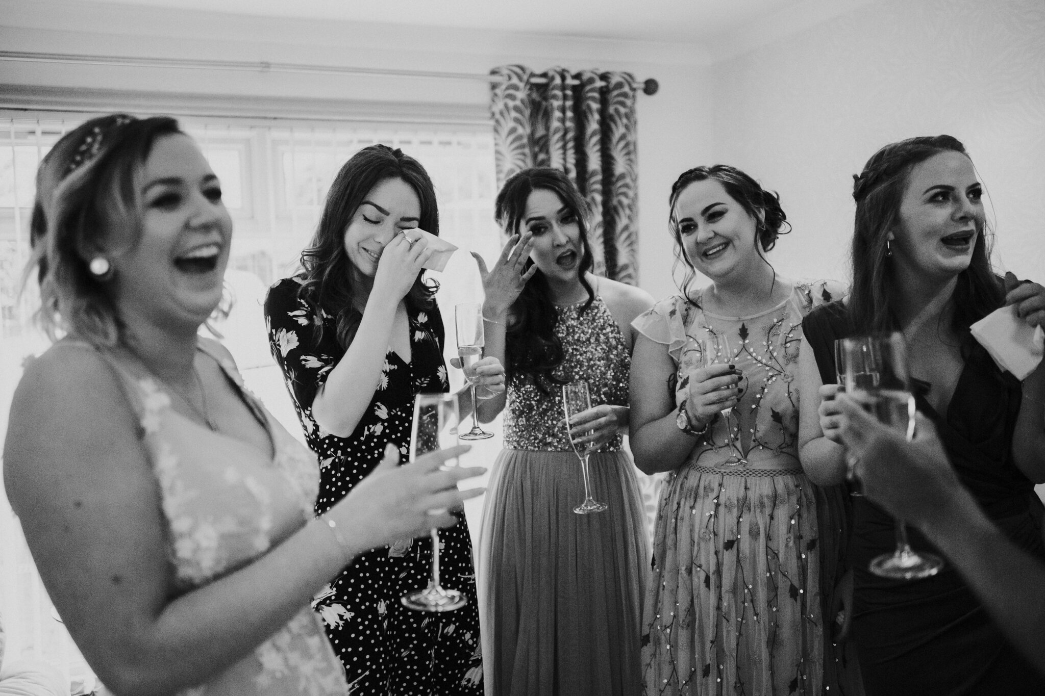 An emotional moment between bridesmaids and the bride
