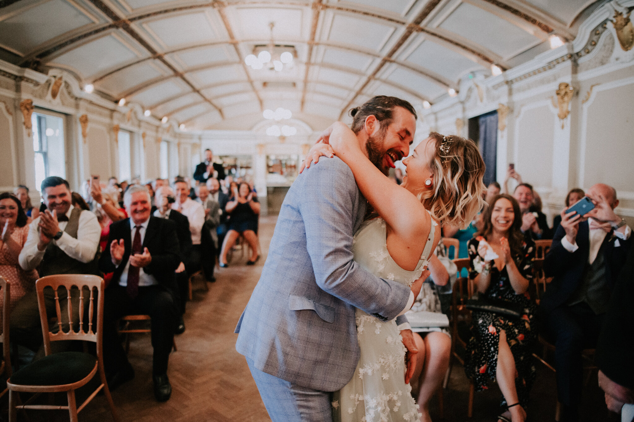 The first fun kiss as a husband and wife at an alternative wedding venue - Sloans
