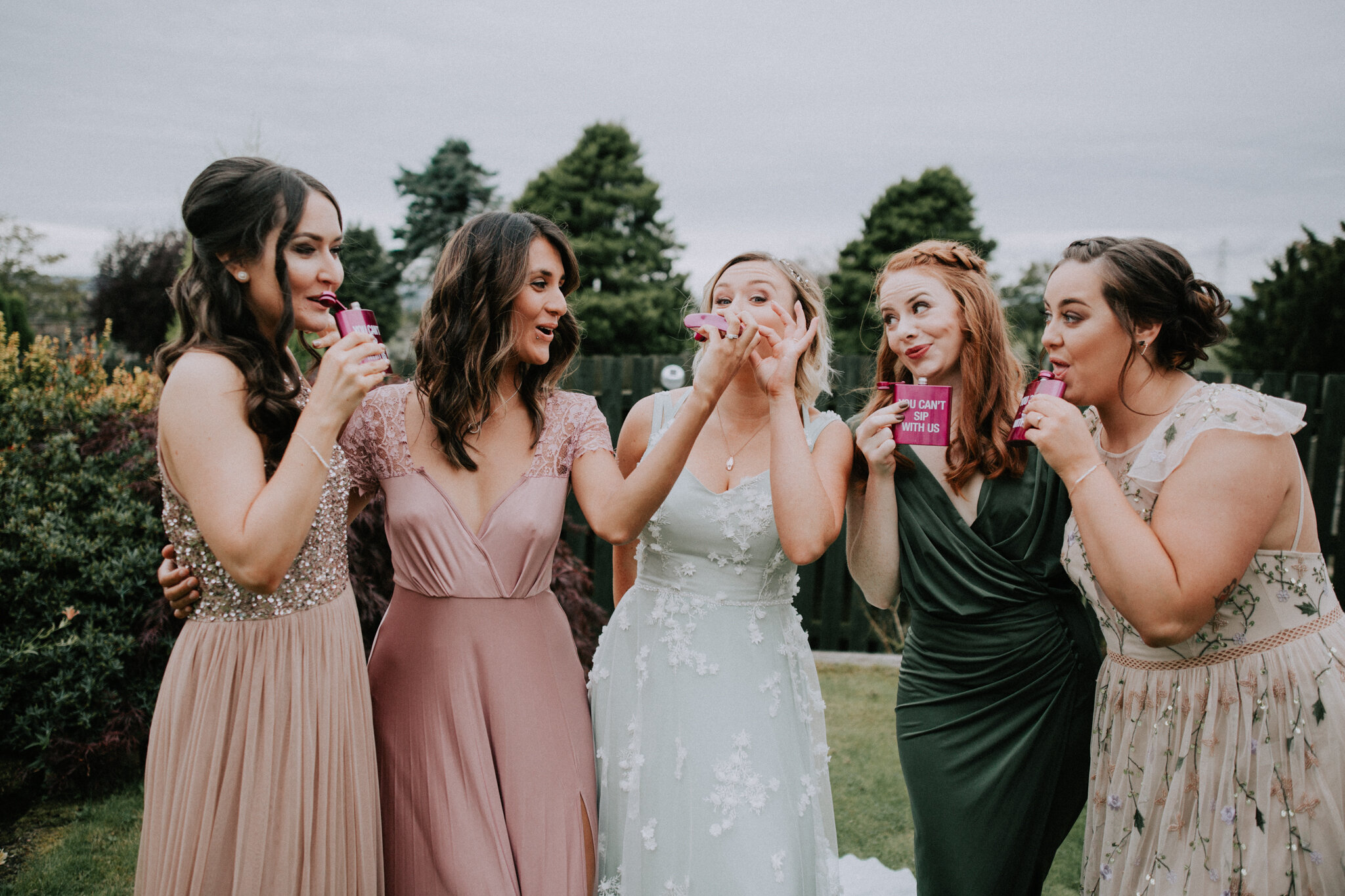The bridal party is having a fun during the bridal preparation