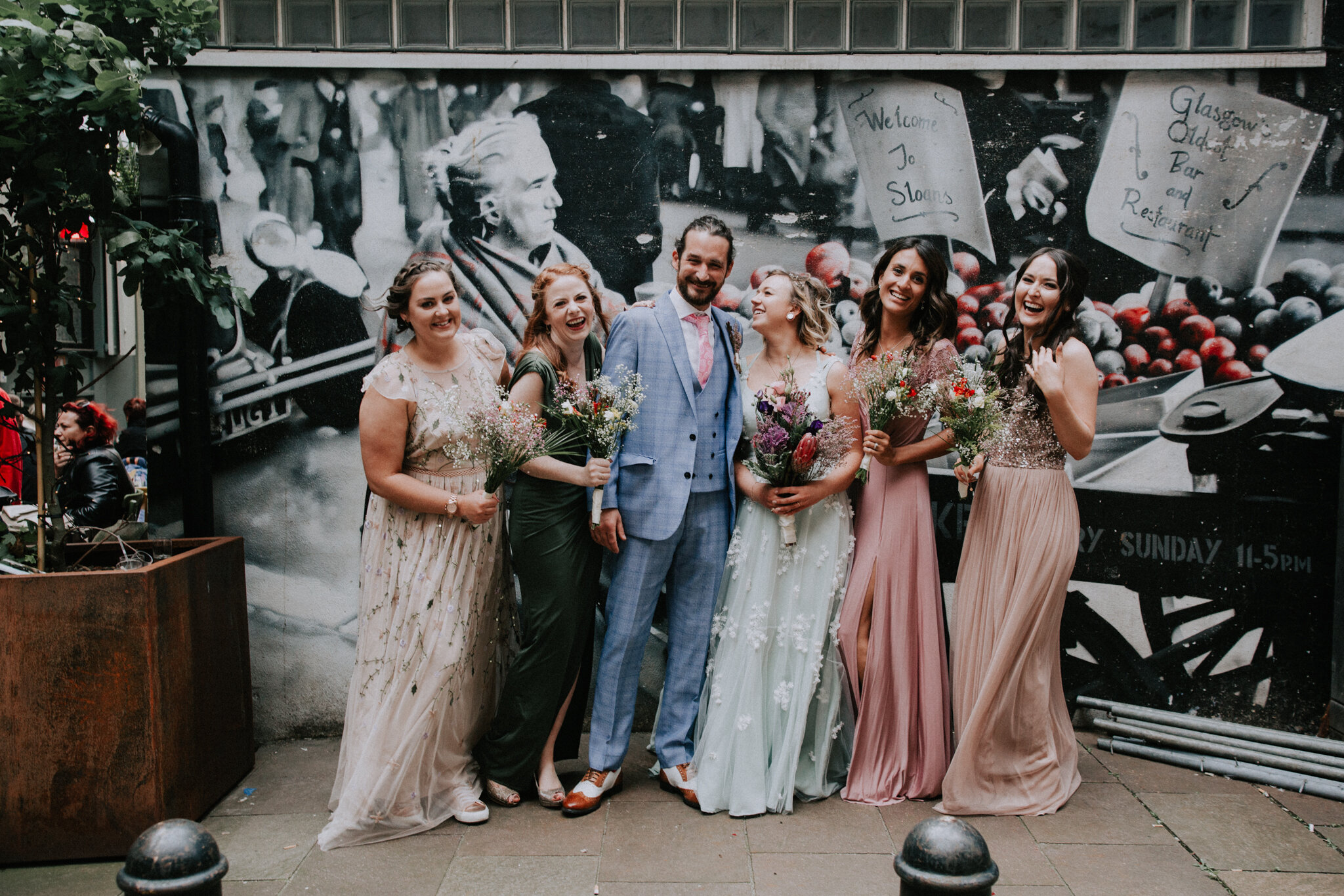 A fun, relaxed and alternative photo with the bridal party at Sloans