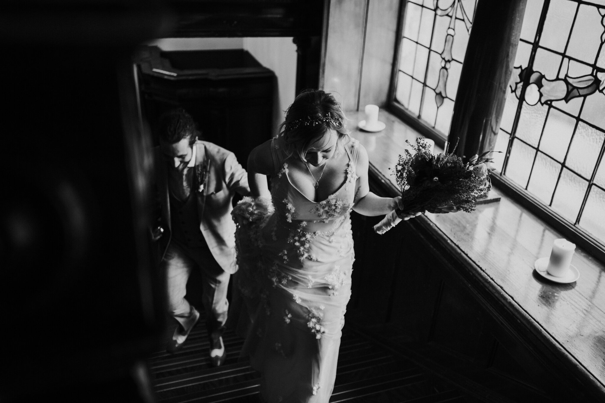 Natural and relaxed shot of the newlyweds are coming upstairs at Sloans