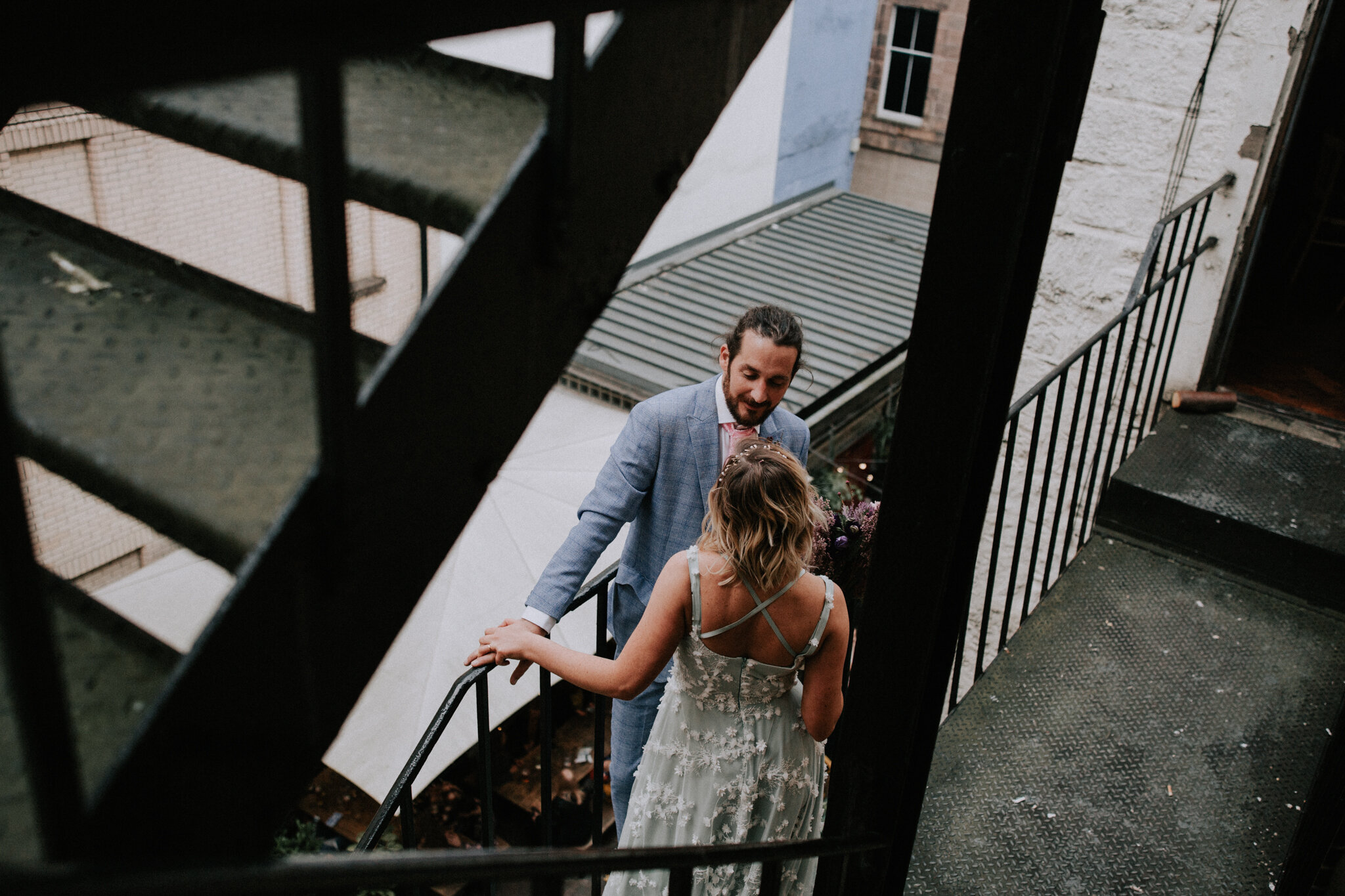 The newlyweds on the fire escape stairs at Sloans