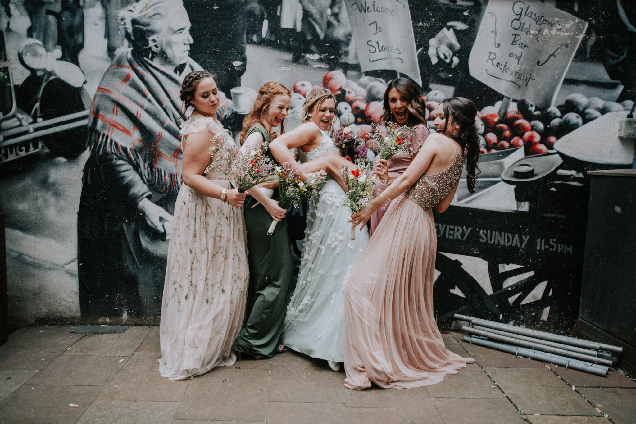 A crazy bridal party on their bridal formals photos at Sloan's