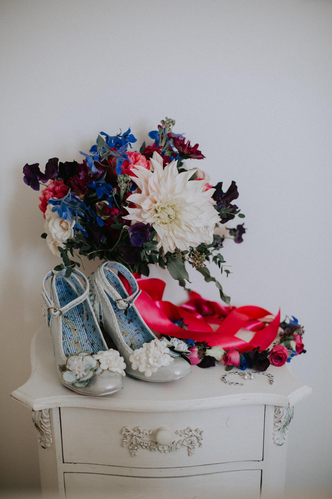 Bride's shoes and wedding bouquet shot