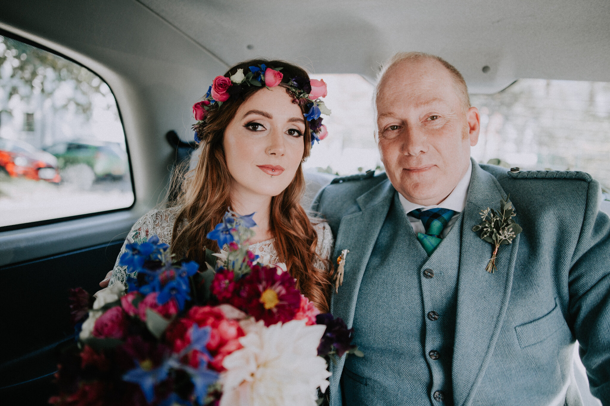 The photo of the bride and father of the bride in the car