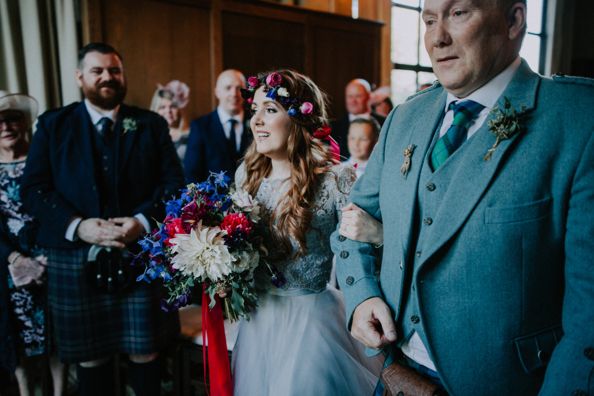 The bride is happily walking with the father