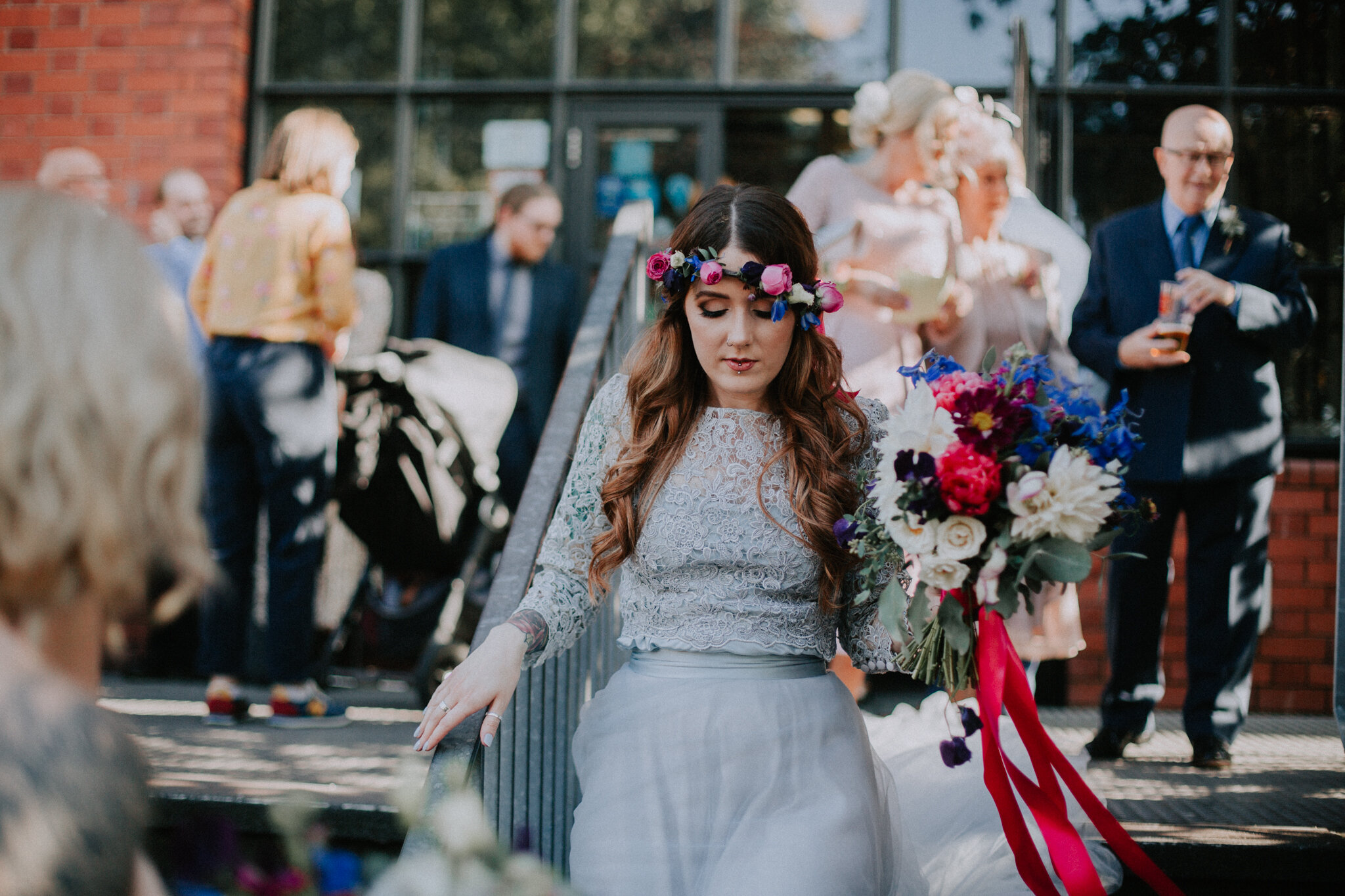 Candid photo of the bride is walking to the family formals