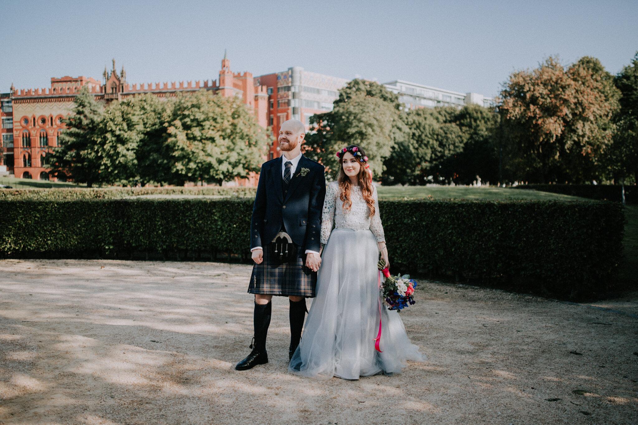 Alternative wedding couple on their photo shoot at the Glasgow Green
