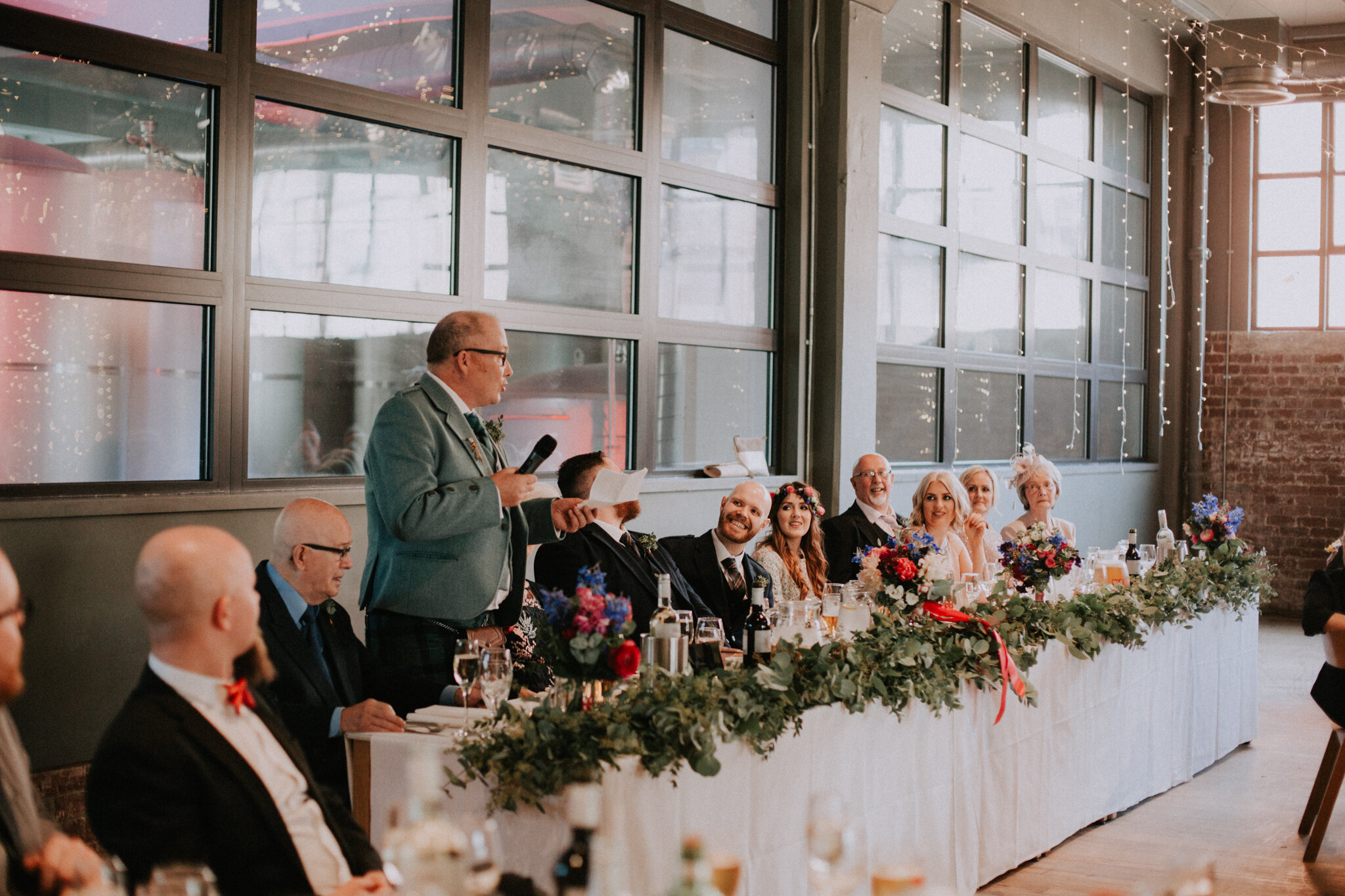 The father of the bride is giving a speech at West on the Green alternative wedding venue