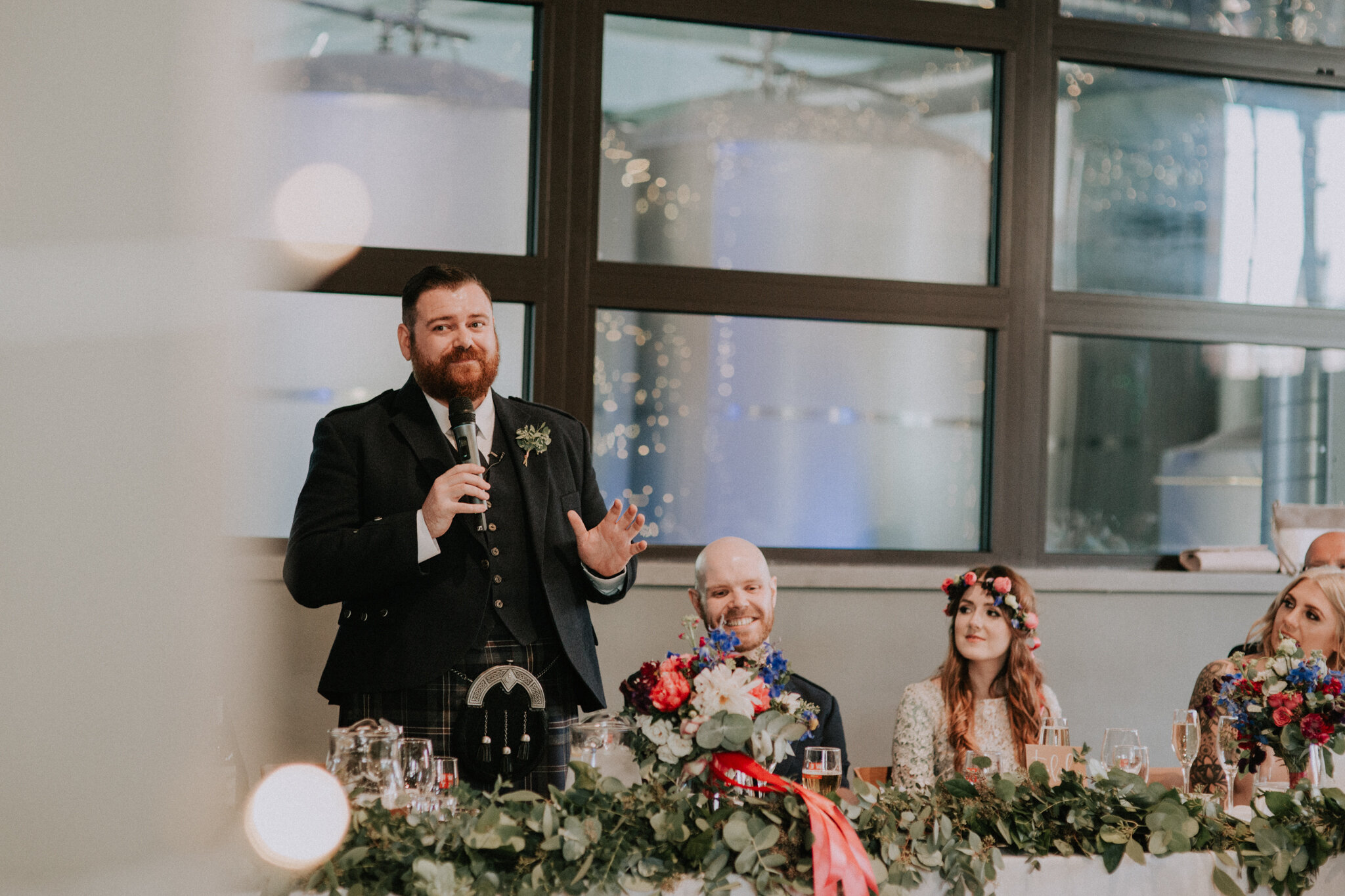 The best man is giving a speech at West on the Green wedding venue in Glasgow