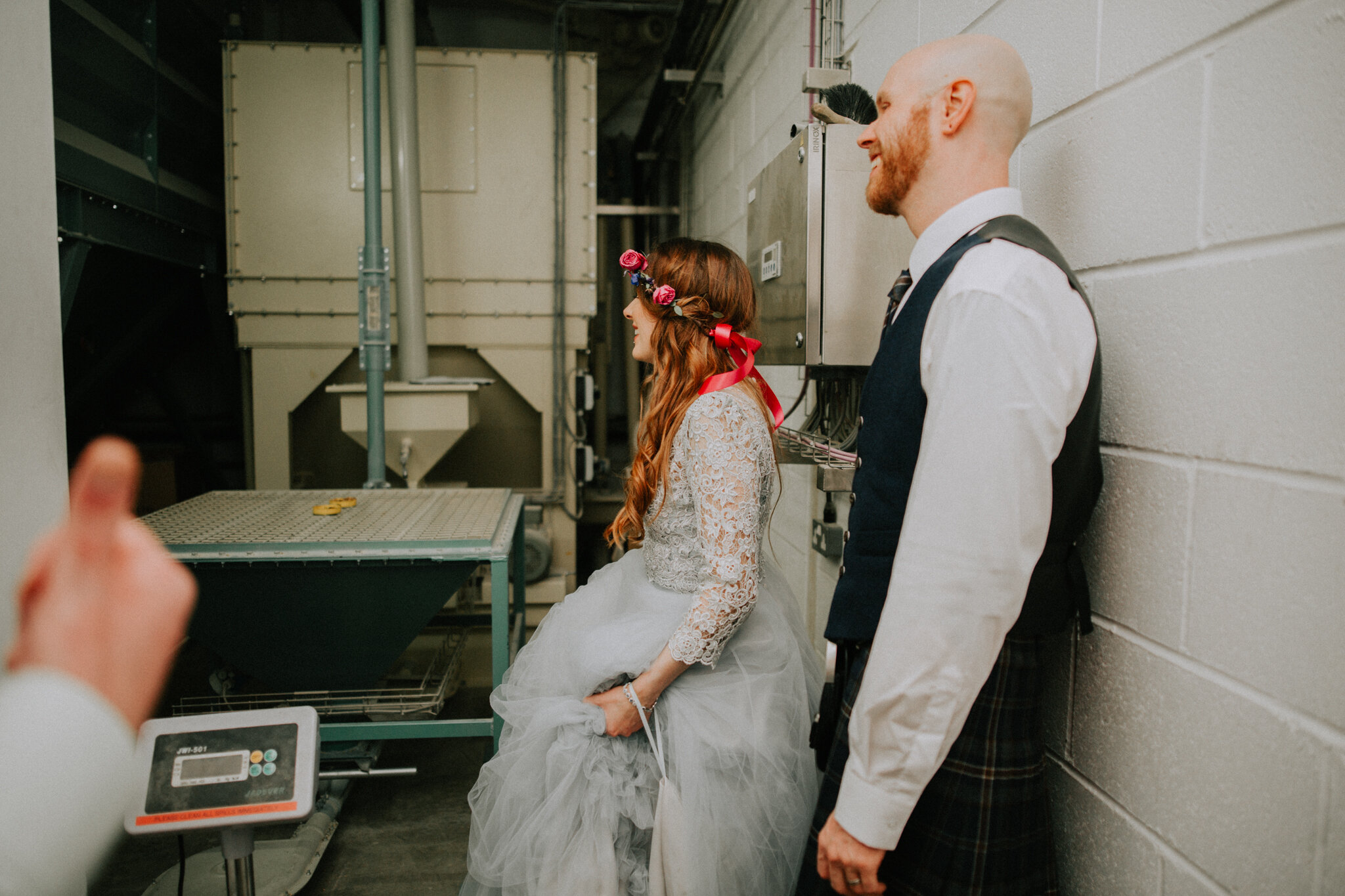 The newlyweds are inside the Brewery for the tour