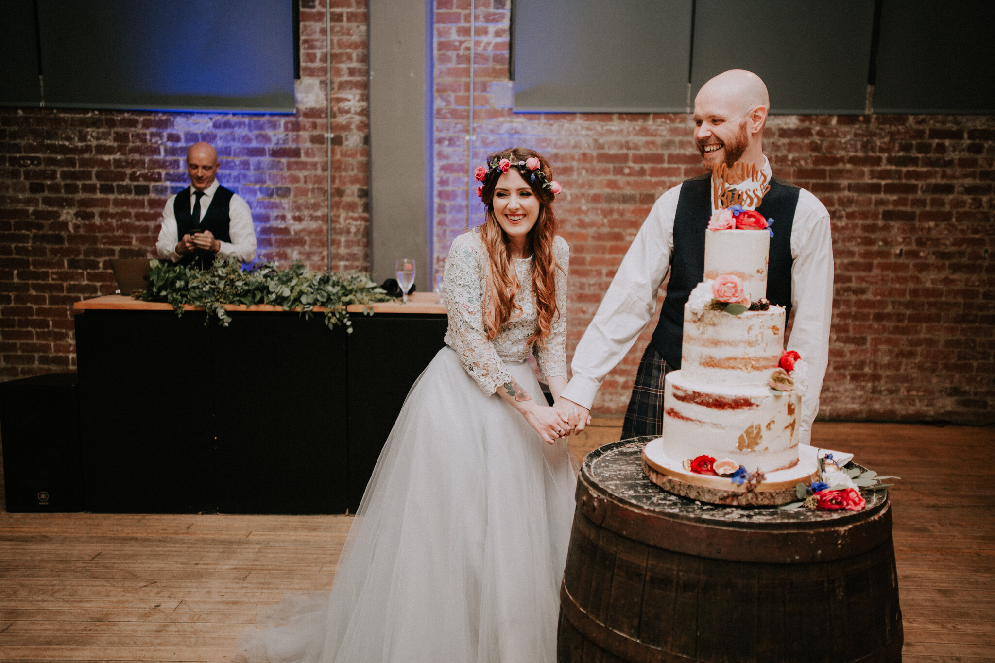 The couple on the evening reception ready to cut a naked cake