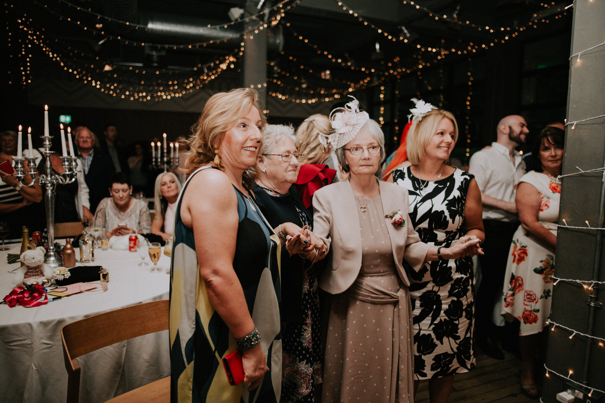 The grandmother is watching the first dance