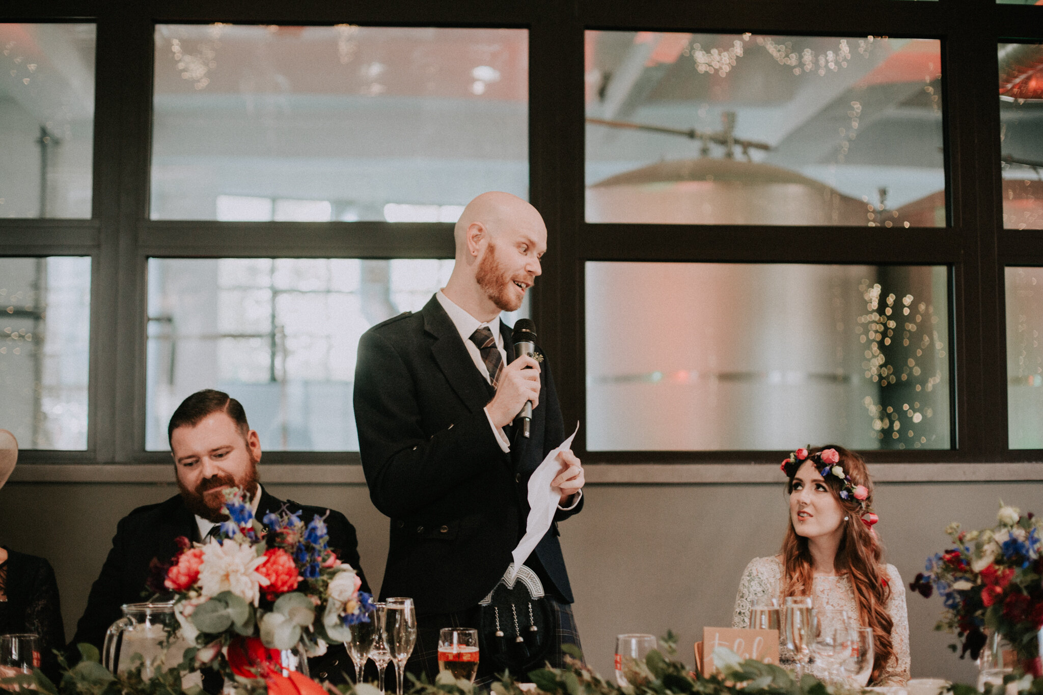 The groom is giving a speech at West Brewery