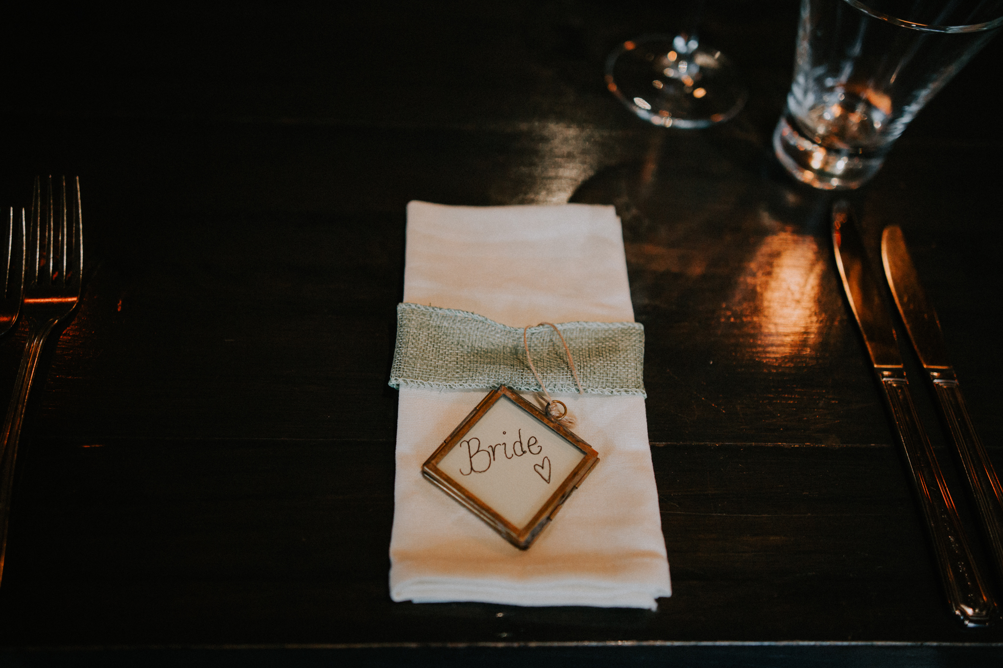The bride's rustic table name at the Bothy