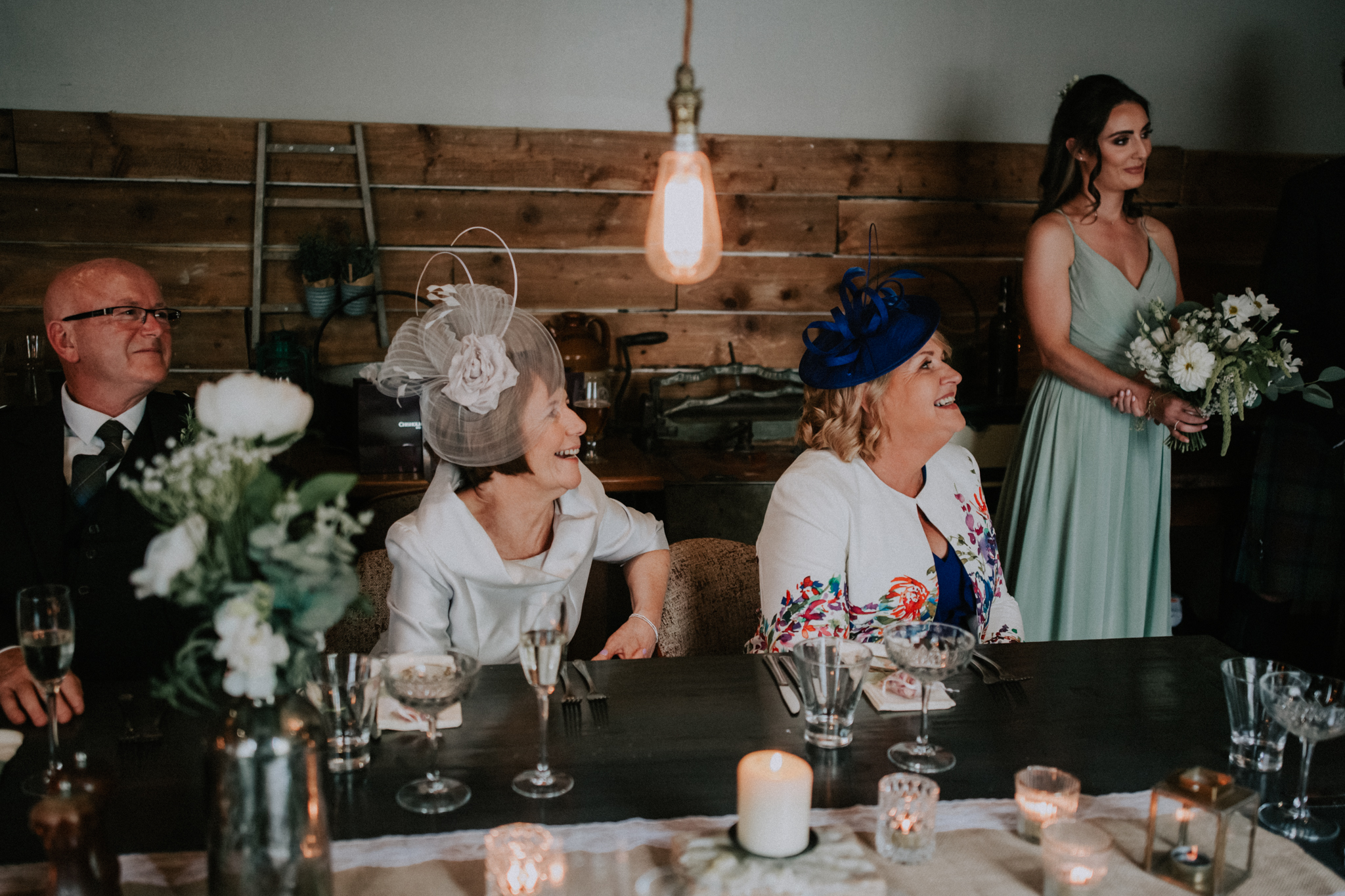 Two mothers are happy during the wedding ceremony at the Bothy