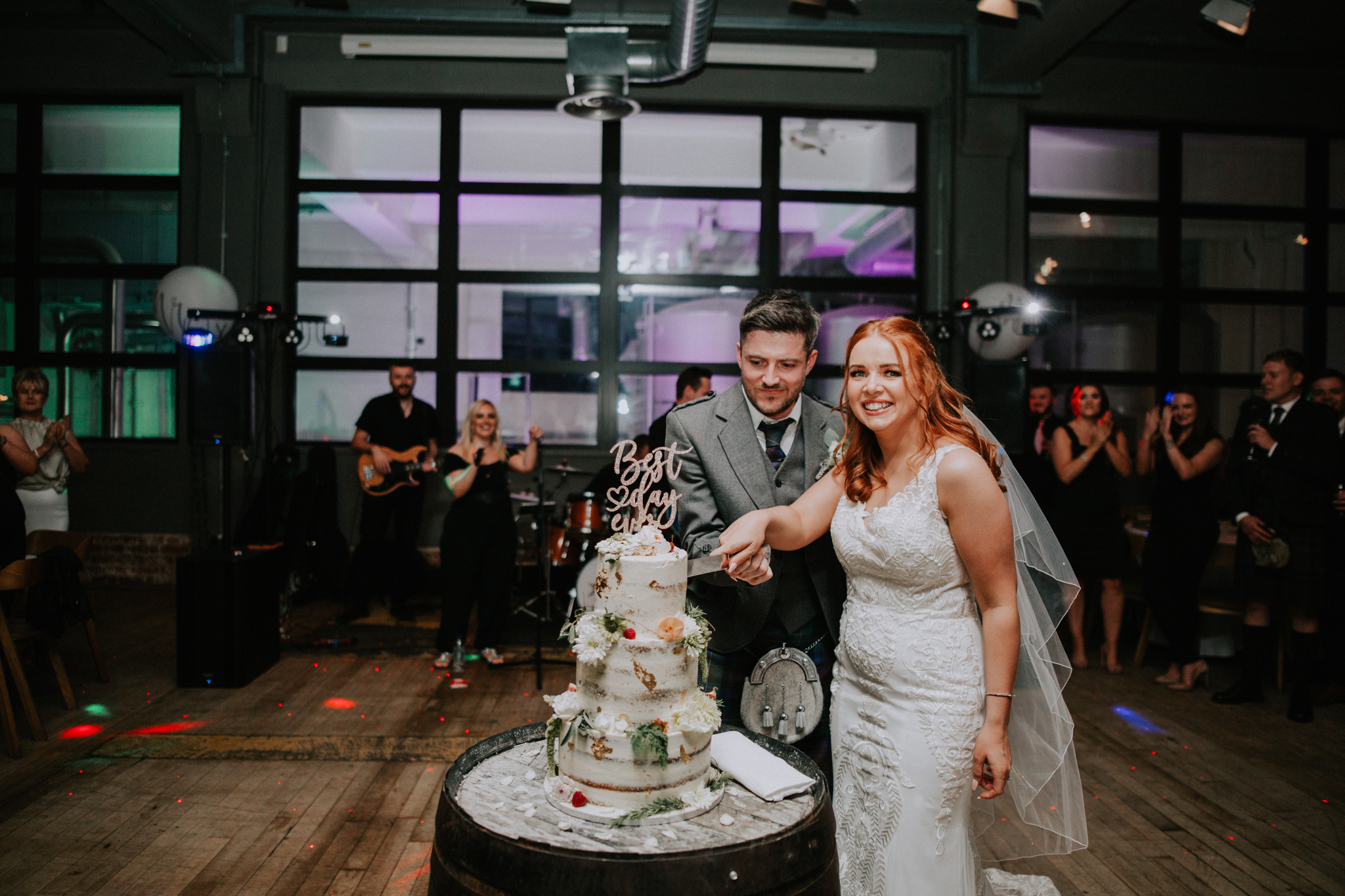 The couple is cutting the semi-naked cake at the West Brewery
