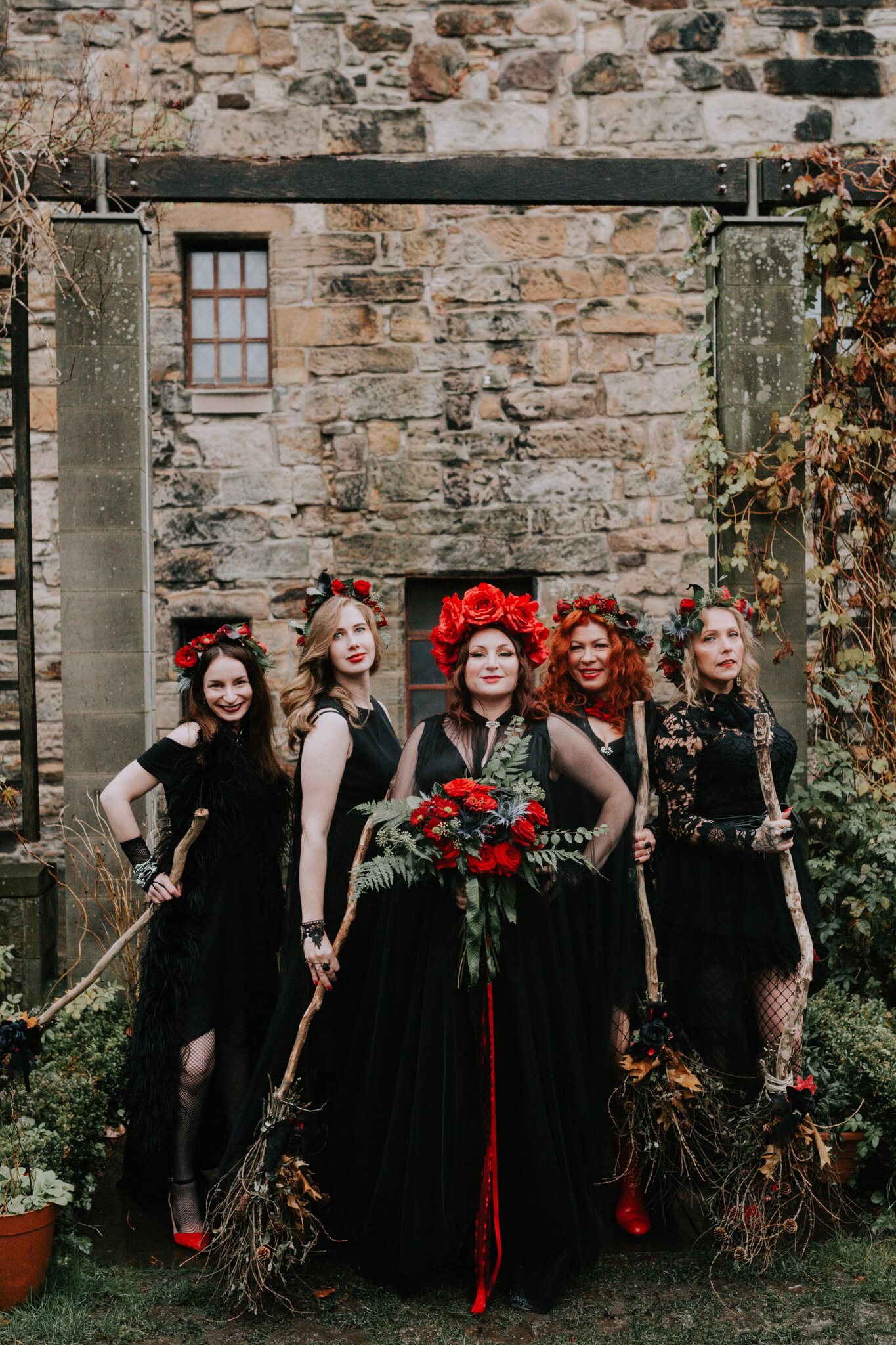 The alternative halloween quirky bridal party in black dresses