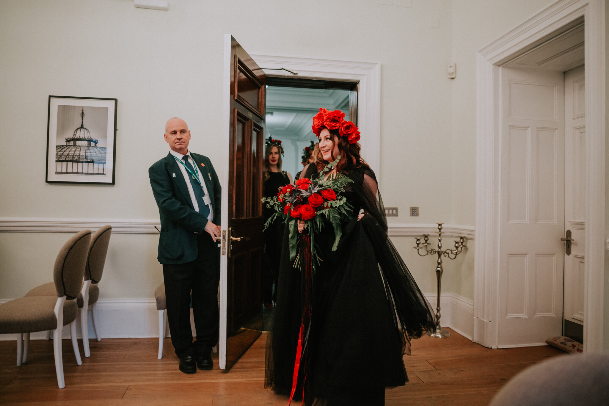 The bride is walking into ceremony room at the 23 Montrose registry office