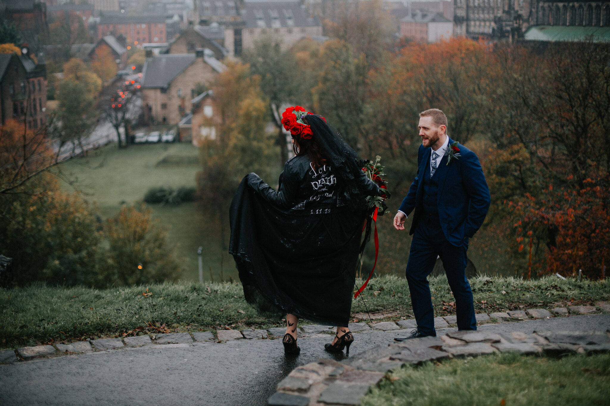 The bride is dancing on the top of Glasgow Cathedral