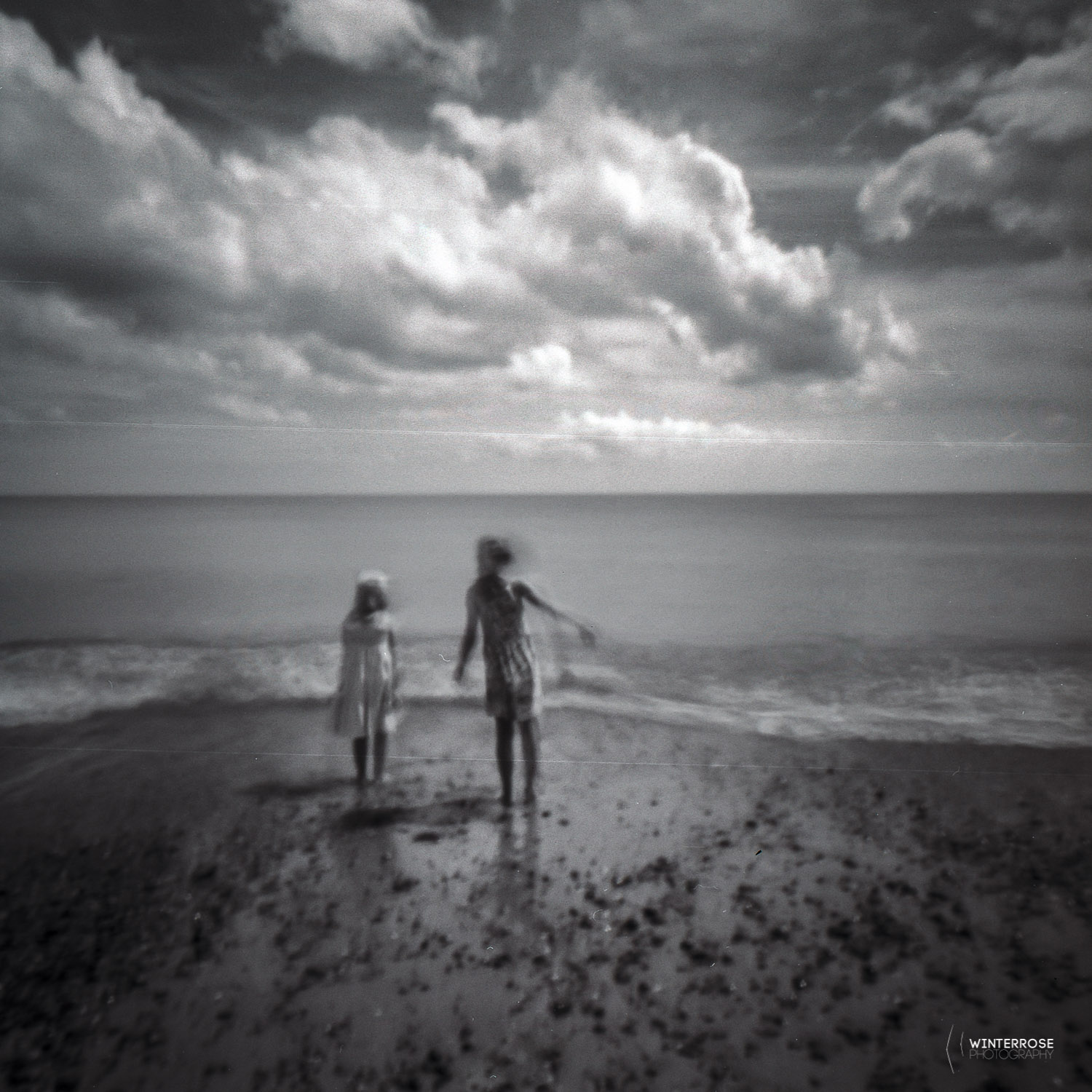 A pretty quick exposure (1 second) for pinhole, but it was an extremely bright day at the beach with the kids. Complete with scratches and dust too!