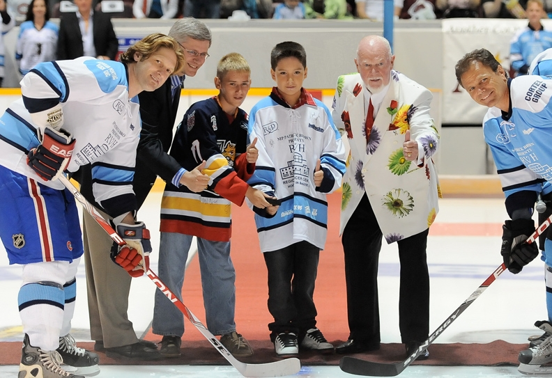 Former PM Stephen Harper & Don Cherry drop the puck for Hockey Night in Barrie with two youth fundraisers from the Barrie Ball Hockey Club.