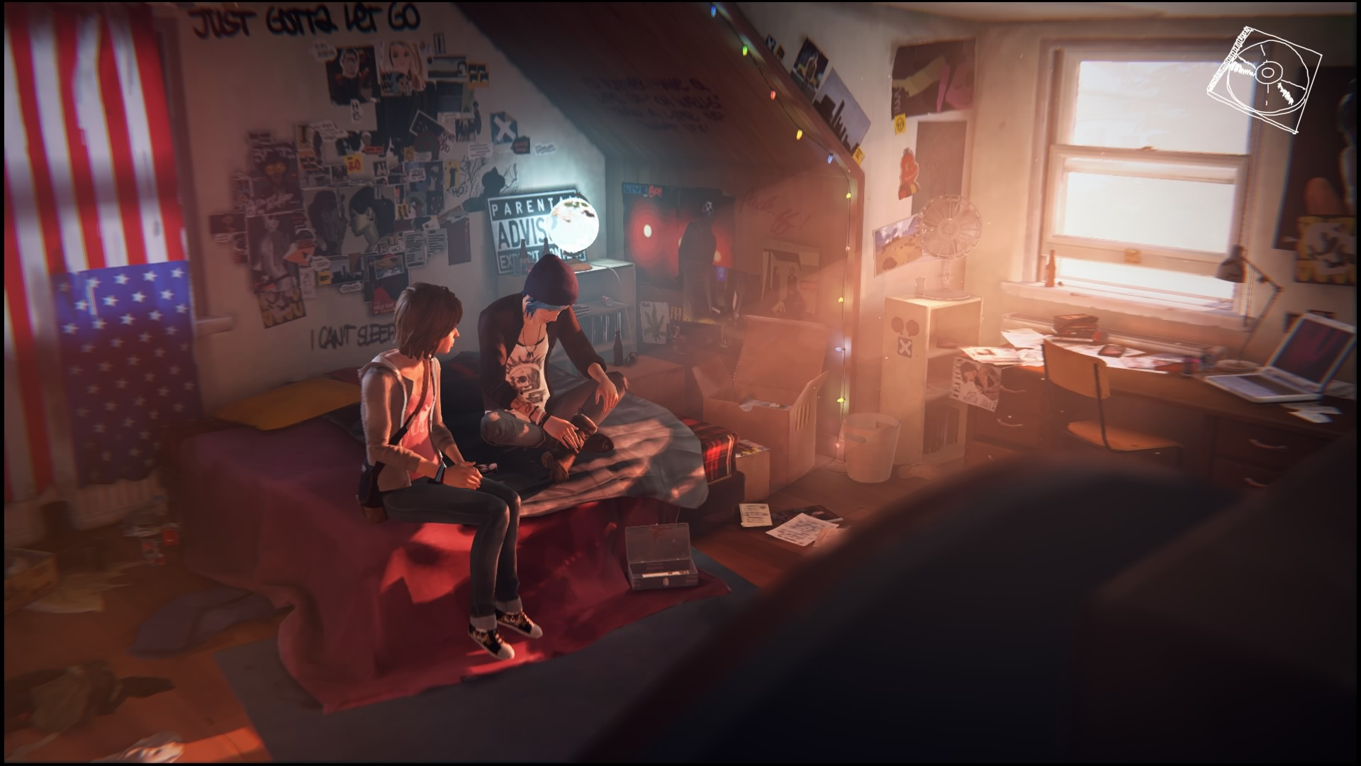 In Chloe's room, Max and Chloe sit together.