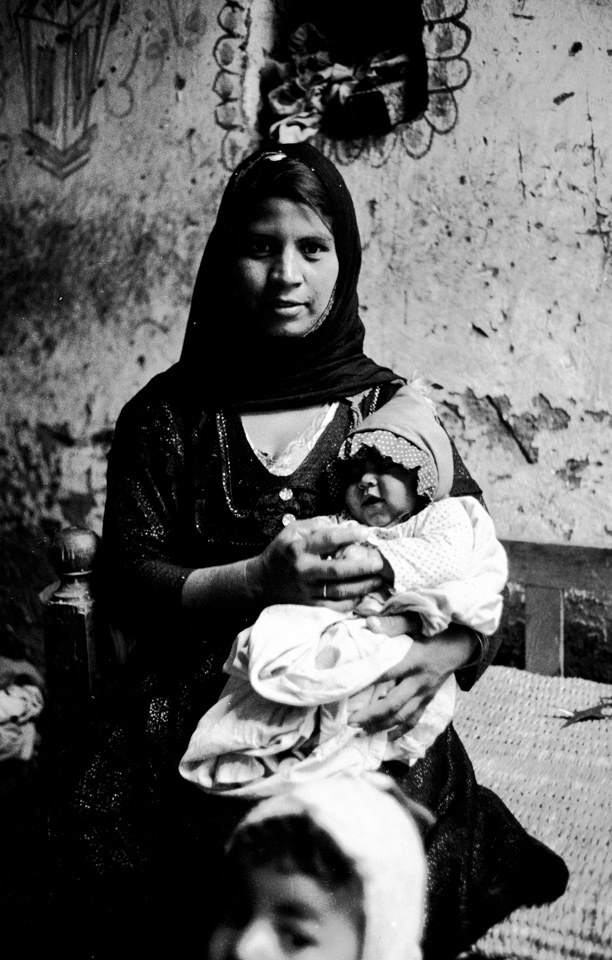 This image was photographed in1983, by Maggie Hallahan, in Luxor, Egypt for UNFPA for a project about female genital mutilation (UNFPA abbreviation is FGM) . A 2016 survey by the U.N. Children's Fund showed that 87 percent of women and girls aged 15-49 in Egypt have undergone the procedure. According to the World Health Organization, more than 200 million girls and women have been cut in 30 countries in Africa, the Middle East and Asia. The intergenerational struggle is the economic, social and educational.