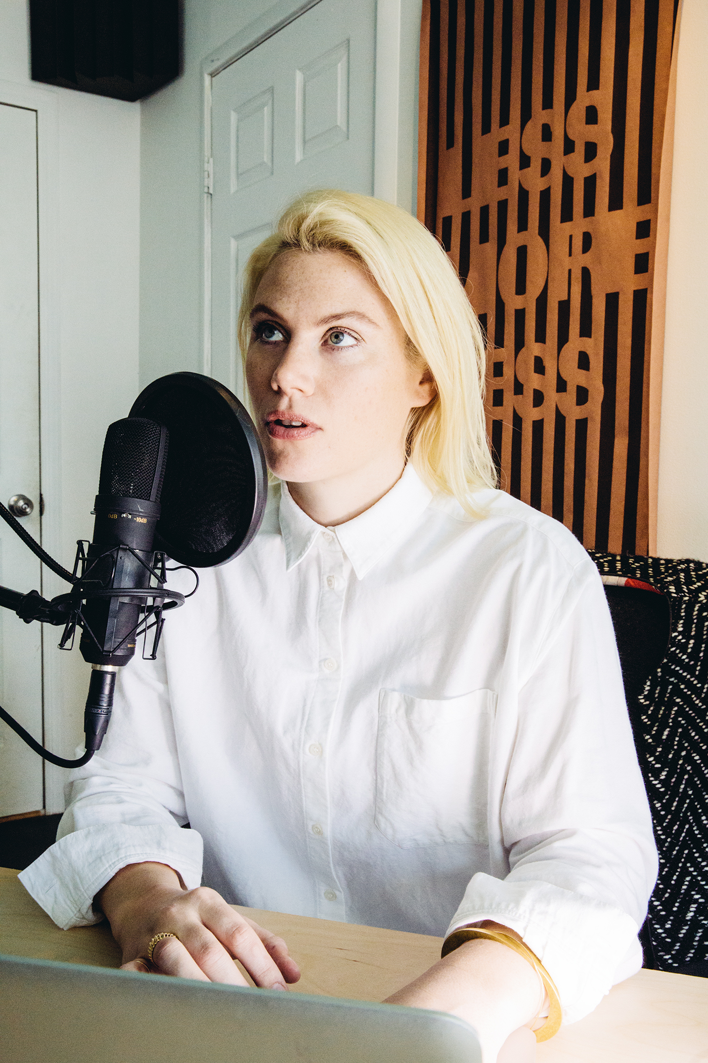 """Julia behind the mic wearing a favorite--""""anything with a collar,"""" she tells me."""