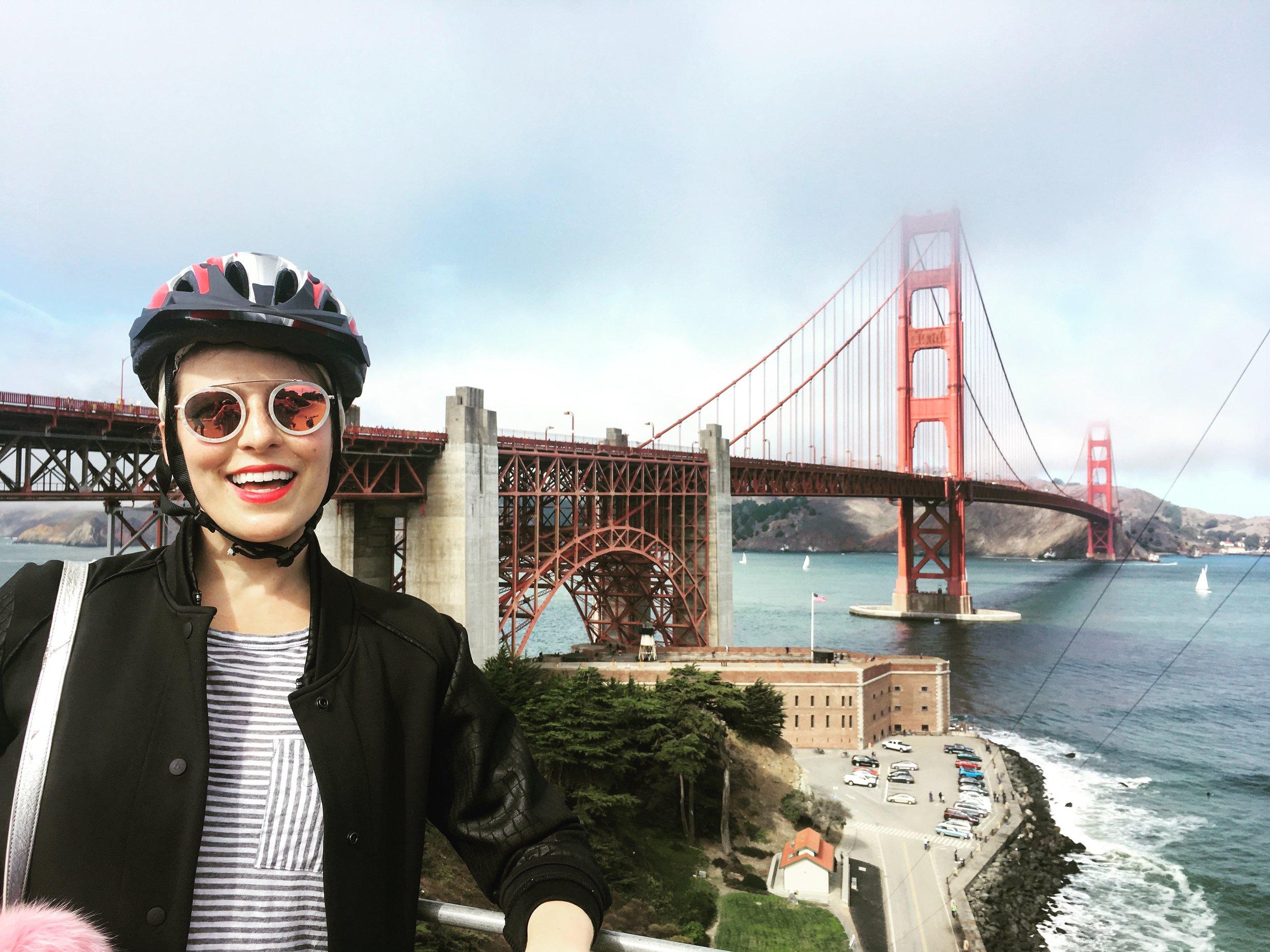 girl biking the golden gate bridge