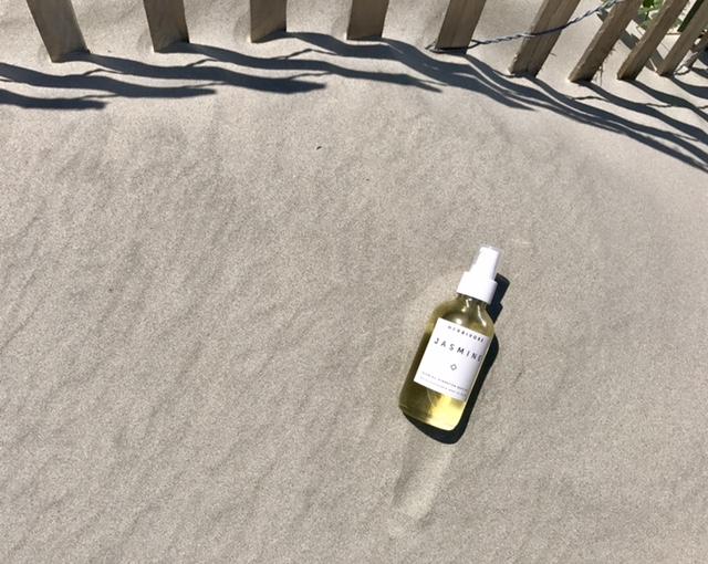 herbivore botanicals body oil in sand