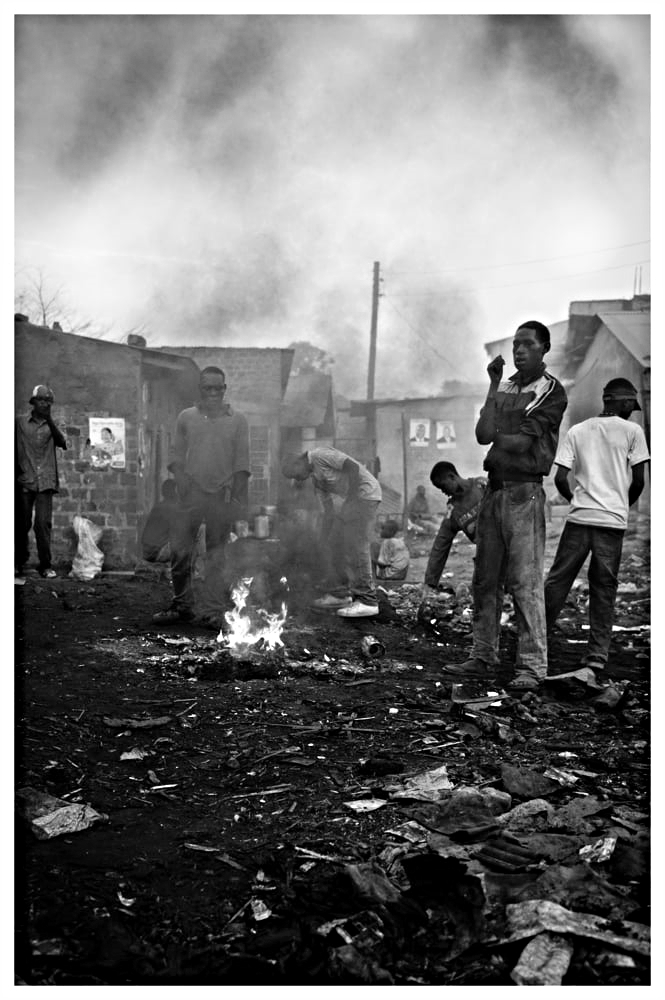 Making pit fires is common throughout the slums of Kampala.