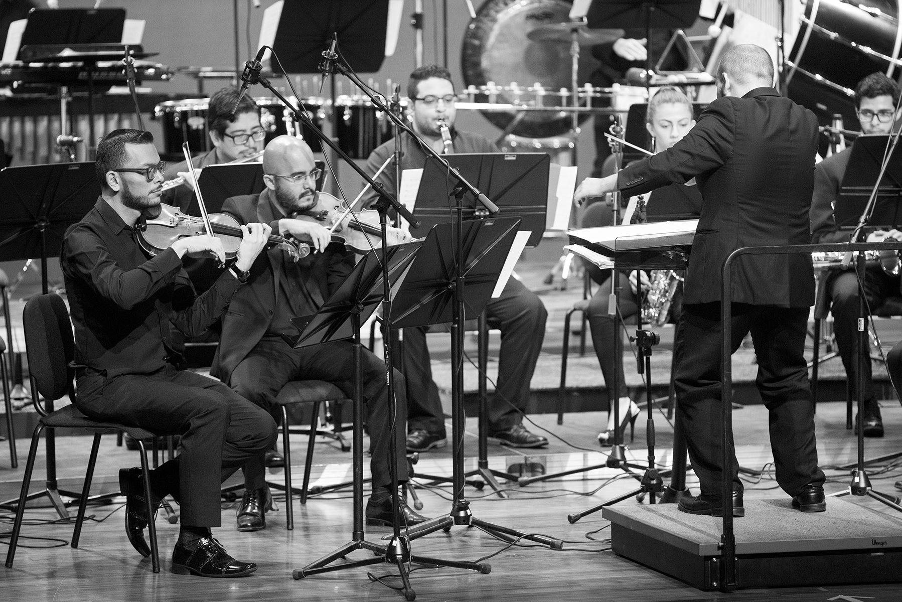 Luis Viquez (right) conducts a chamber ensemble from the Orquesta Sinfónica de Heredia during a concert in San Pedro, Costa Rica. (July 2018)
