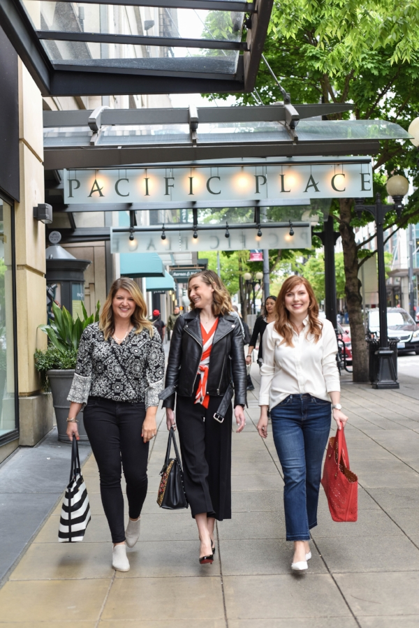 Stylists Darcy and Olga pictured outside our Downtown Seattle Pacific Place Suite