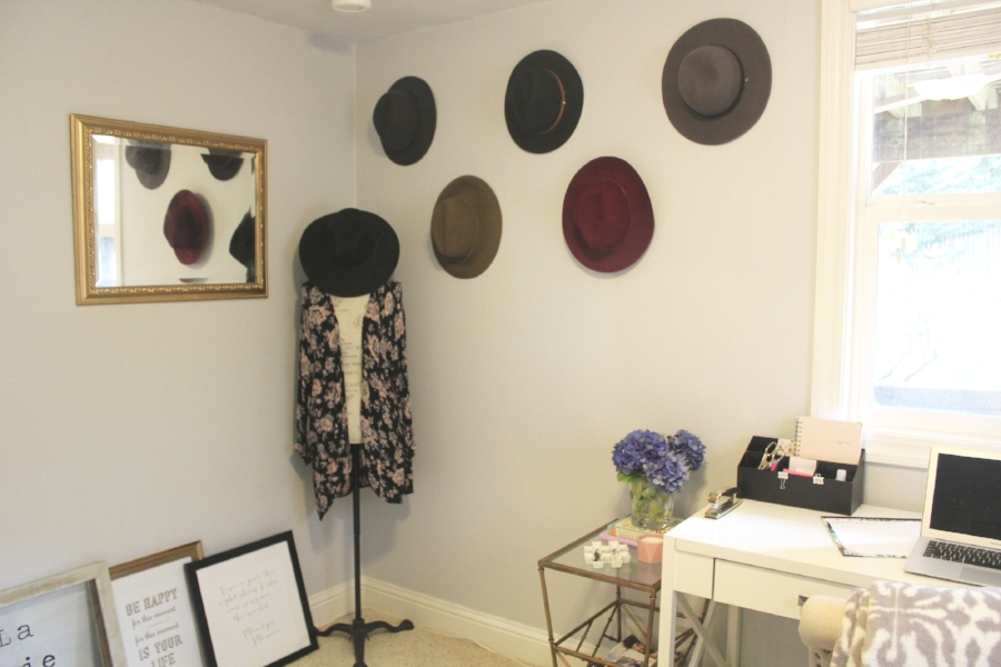 I love the idea of using items you already own as wall art, like these hats!