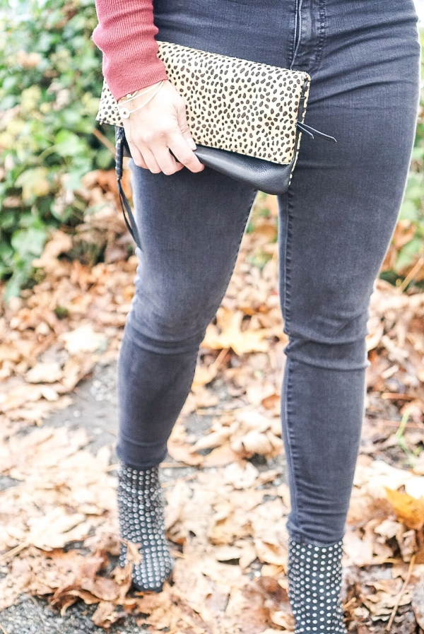 In order to complete your look, you must add accessories, and leopard is always a good idea! This    clutch    is genuine leather and calf hair and can be worn on the opposite side to show more leather and just a pop of leather! Also comes with a crossbody strap to be worn as a bag!