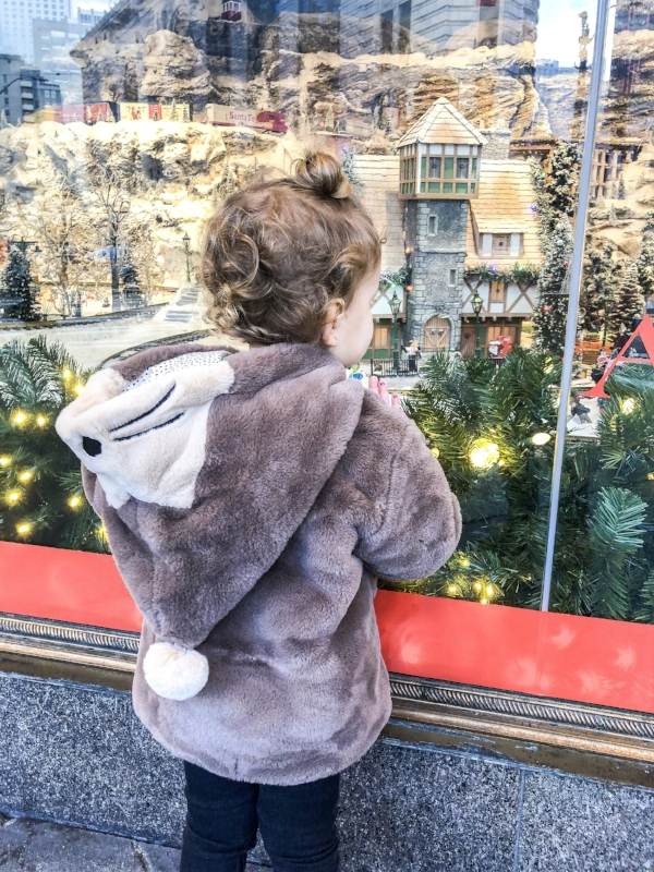 Tayler staring at the Macy's Train Window in Downtown Seattle.