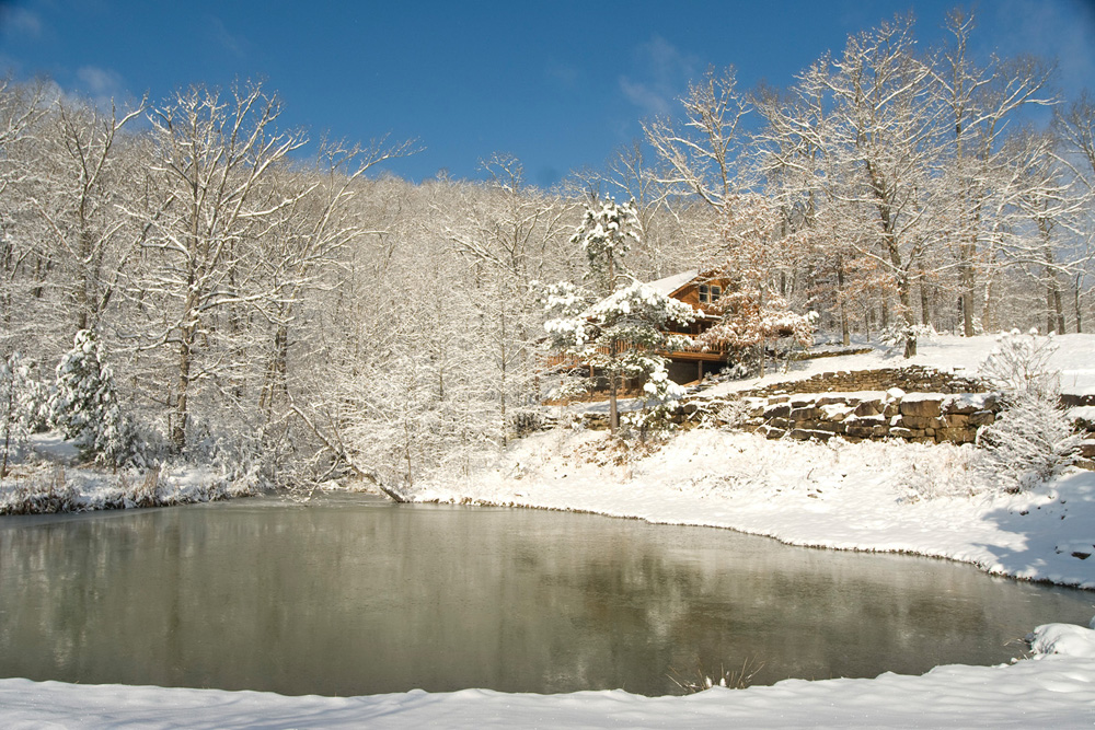 Cabin and pond in winter