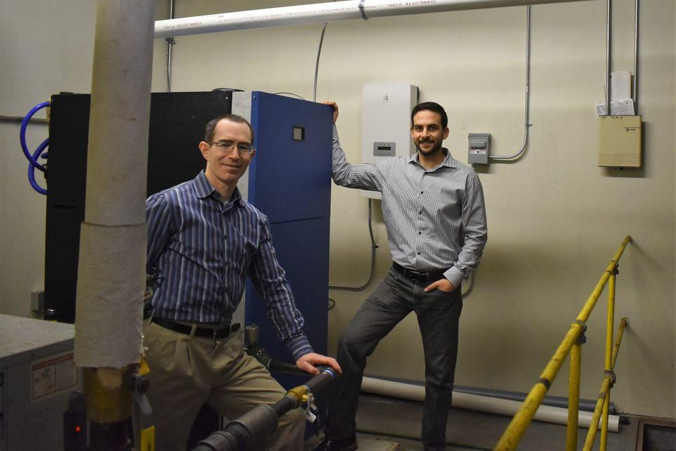 Dan Nadav (left) and Mike Cocuzza (right) at the installation of their SmartWatt boiler beta unit in Hartford, Connecticut.