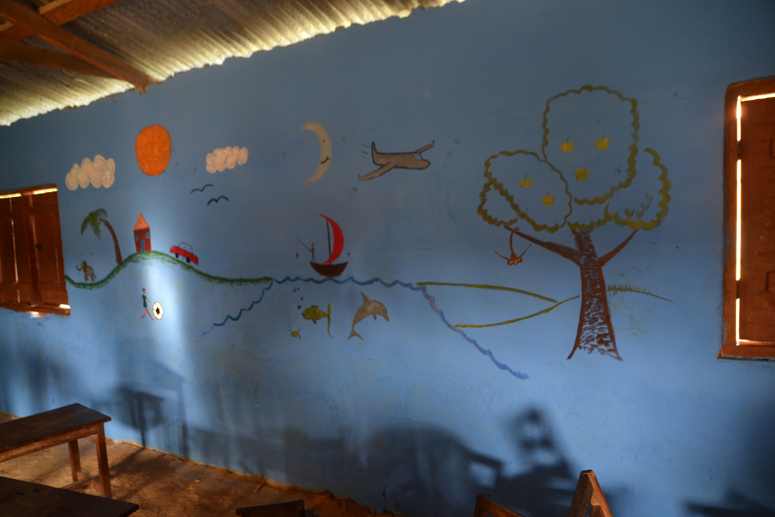 Painting murals for kids to learn simple words; airplane, tree, elephant..