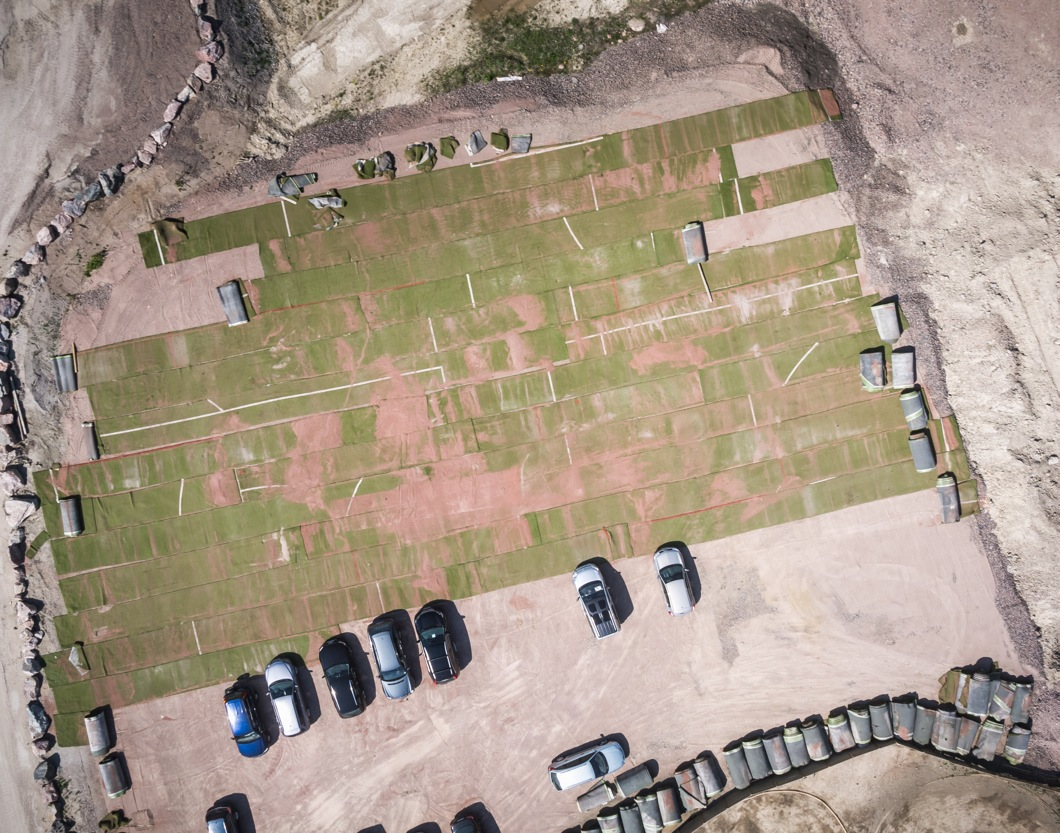 Aerial photo of the track area under construction. Size about 50x30m, the brown coloured material is rubber filler that has been removed.